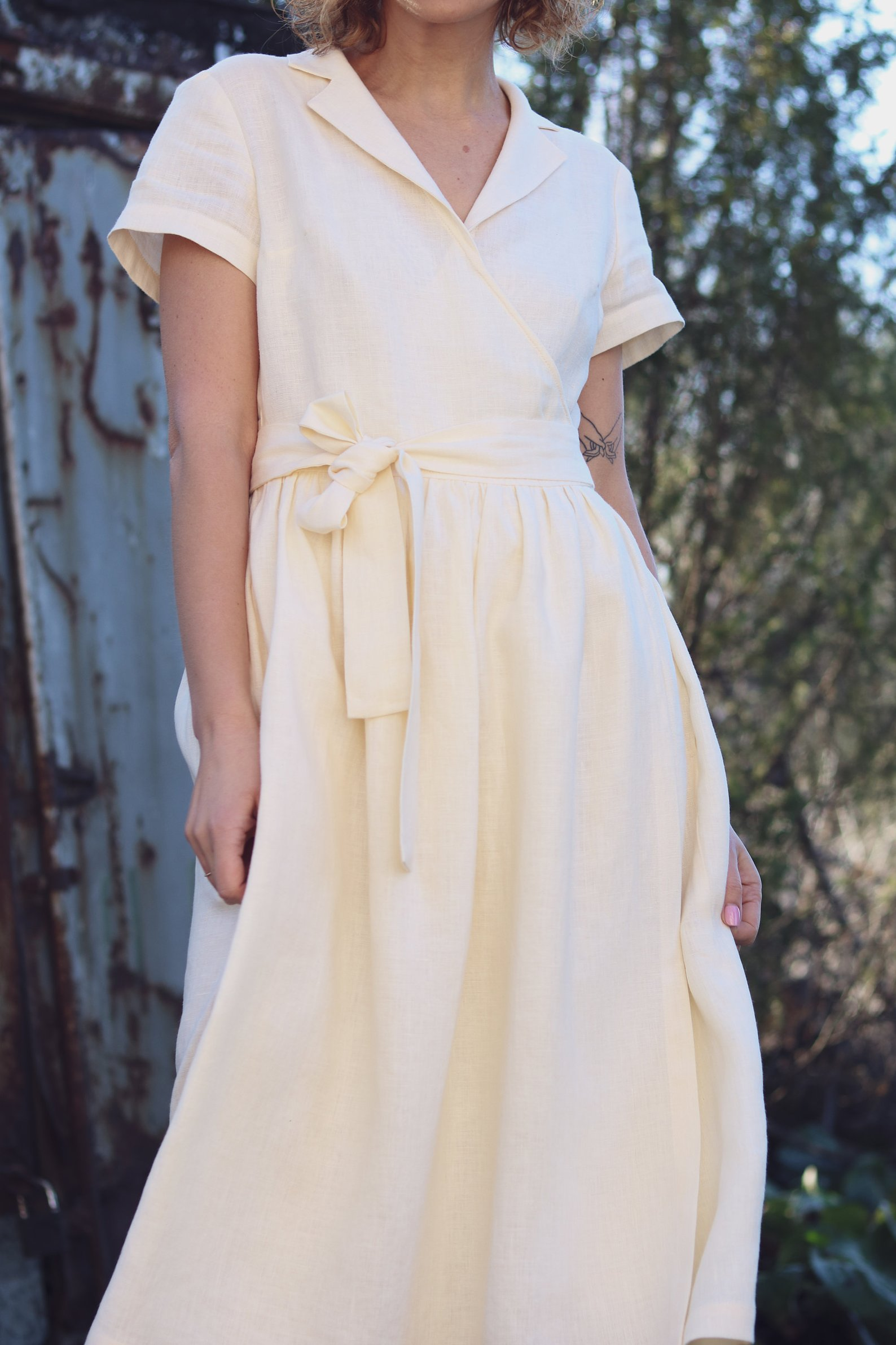 OFF/ON Clothing - Linen Wrap Dress in Ivory.This gorgeous timeless dress is the perfect example of a piece that can last through many seasons and years. The linen provides breathability for warm days and the collar makes it great for a professional setting and a fun day out!