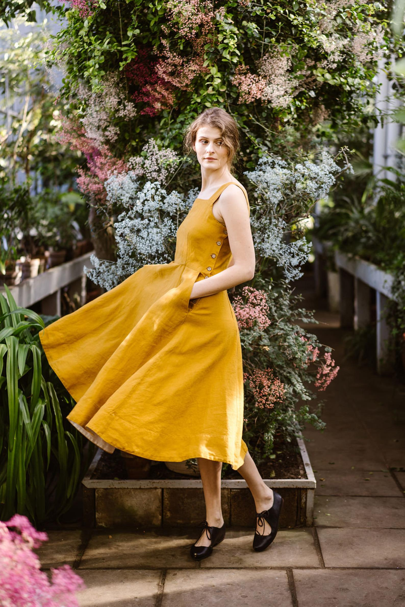 Sondeflor - Mustard Pinafore DressMy mustard color dreams. I love the coverage of this dress and the movement in the skirt, which adds an element of formality to the dress without making it extravagant. An easy dress to style up for a special event, or down for a regular summer day.