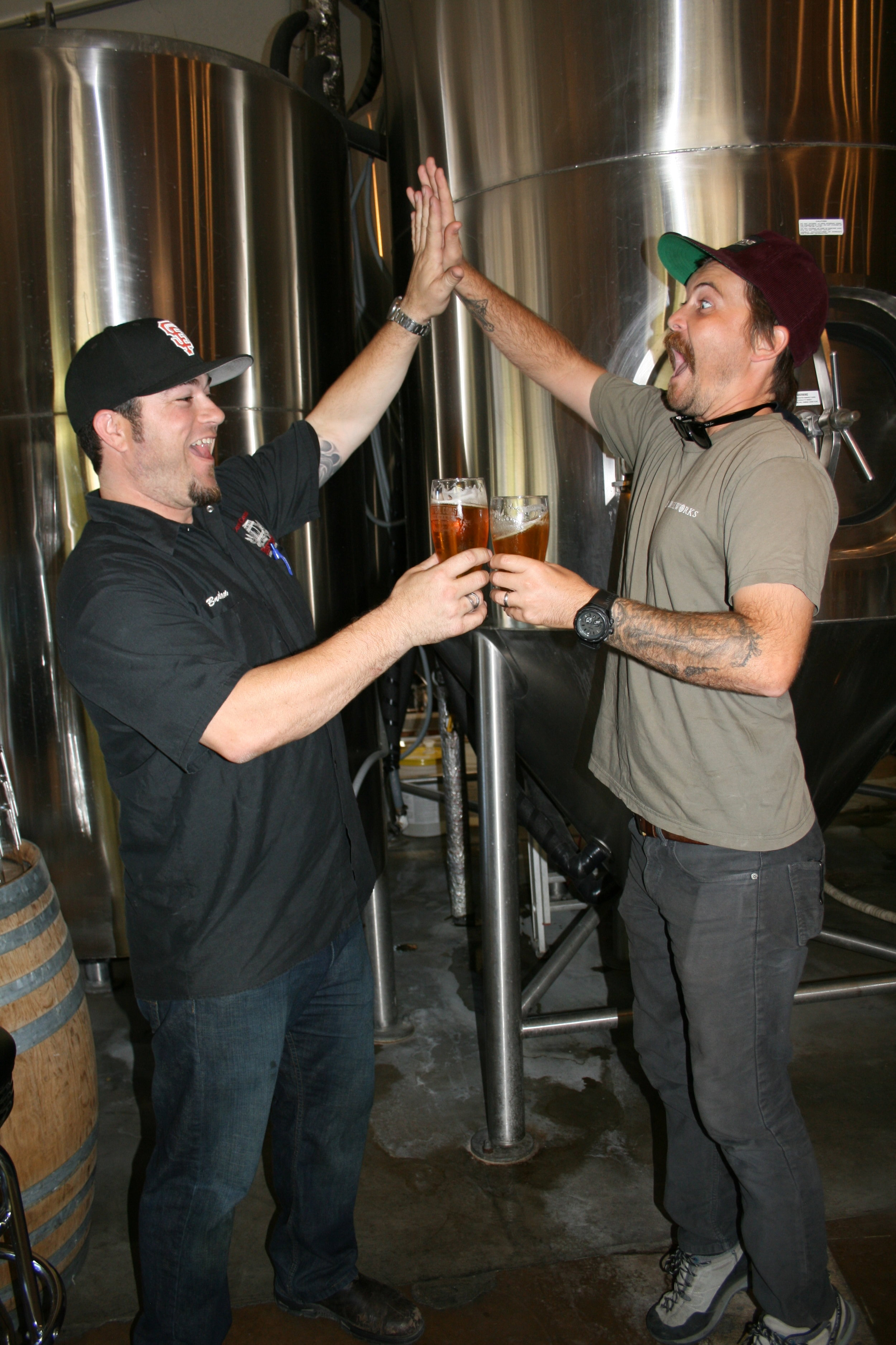 "BEER FIVE   Central Coast Brewing Co. Head Brewer Brendan Gough (left) and Libertine Brewing Co. Co-Owner/Brewmaster Tyler Clark go for a ""high-five/beer-five."""