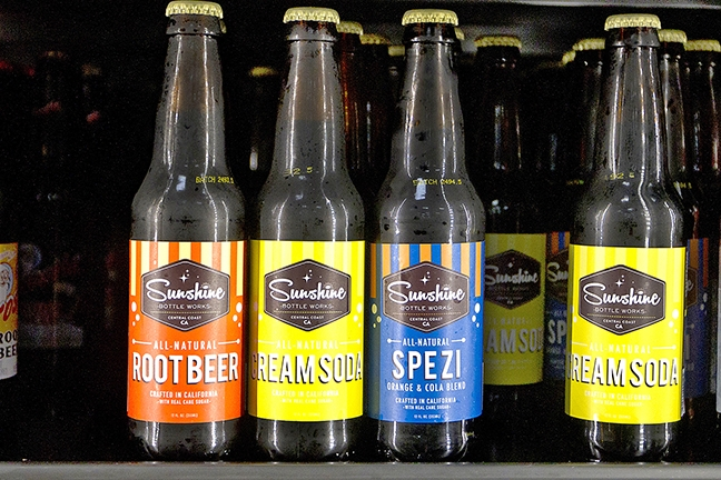 "SUNSHINE IN A BOTTLE     Crafted on the Central Coast with cane sugar and natural ingredients, Sunshine Bottle Works offers up a refreshing alternative to commercially produced soda pop. Could ""craft soda"" be the next ""craft beer""?    PHOTO BY JAYSON MELLOM"