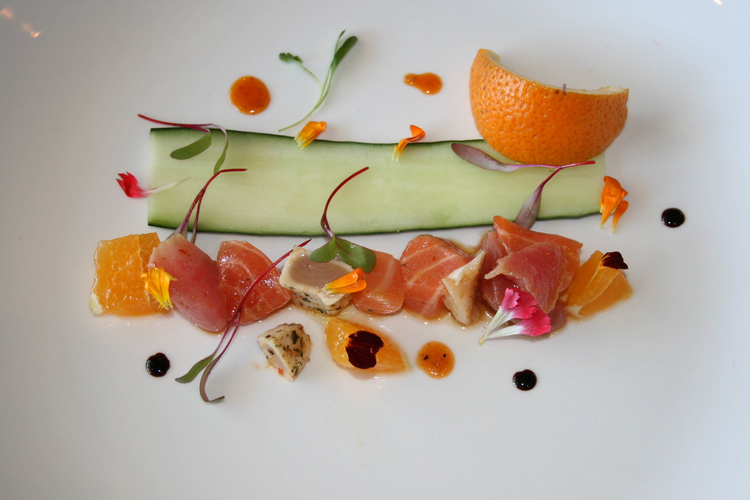 FREESTYLE  At Arigato, ahi and salmon sashimi mingle with zesty citrus and a dose of herbaceous Spring greens.