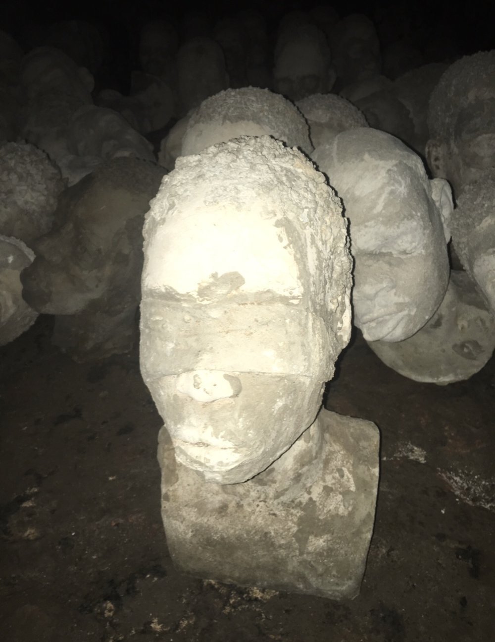 In the dungeons, 1,300 concrete heads are on display that depict some of the lives that were transplanted. Each is different and show the possible faces of Africans slaved at Cape Coast Castle.