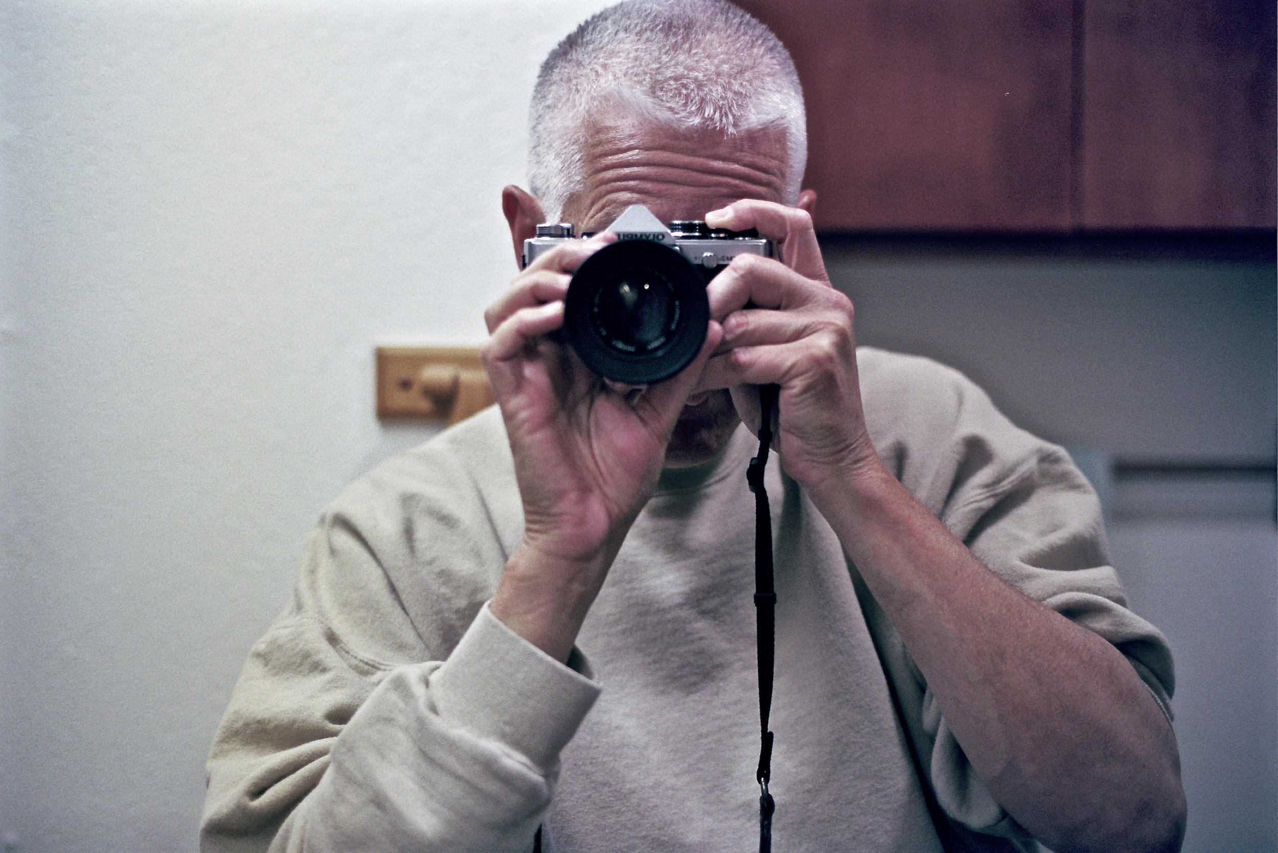 Me with the OM2n on expired Portra 400