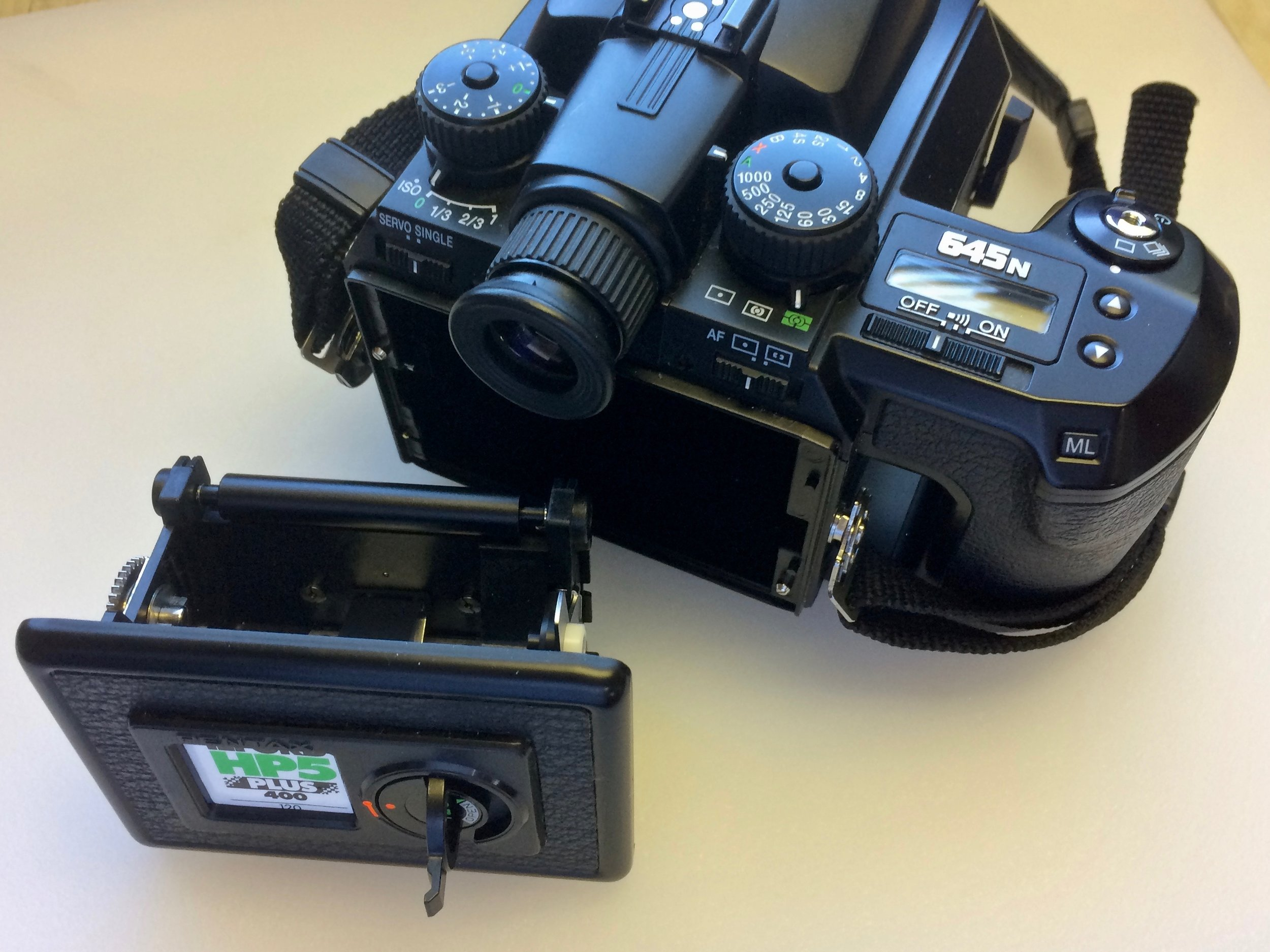 The Pentax 645n uses removable film inserts