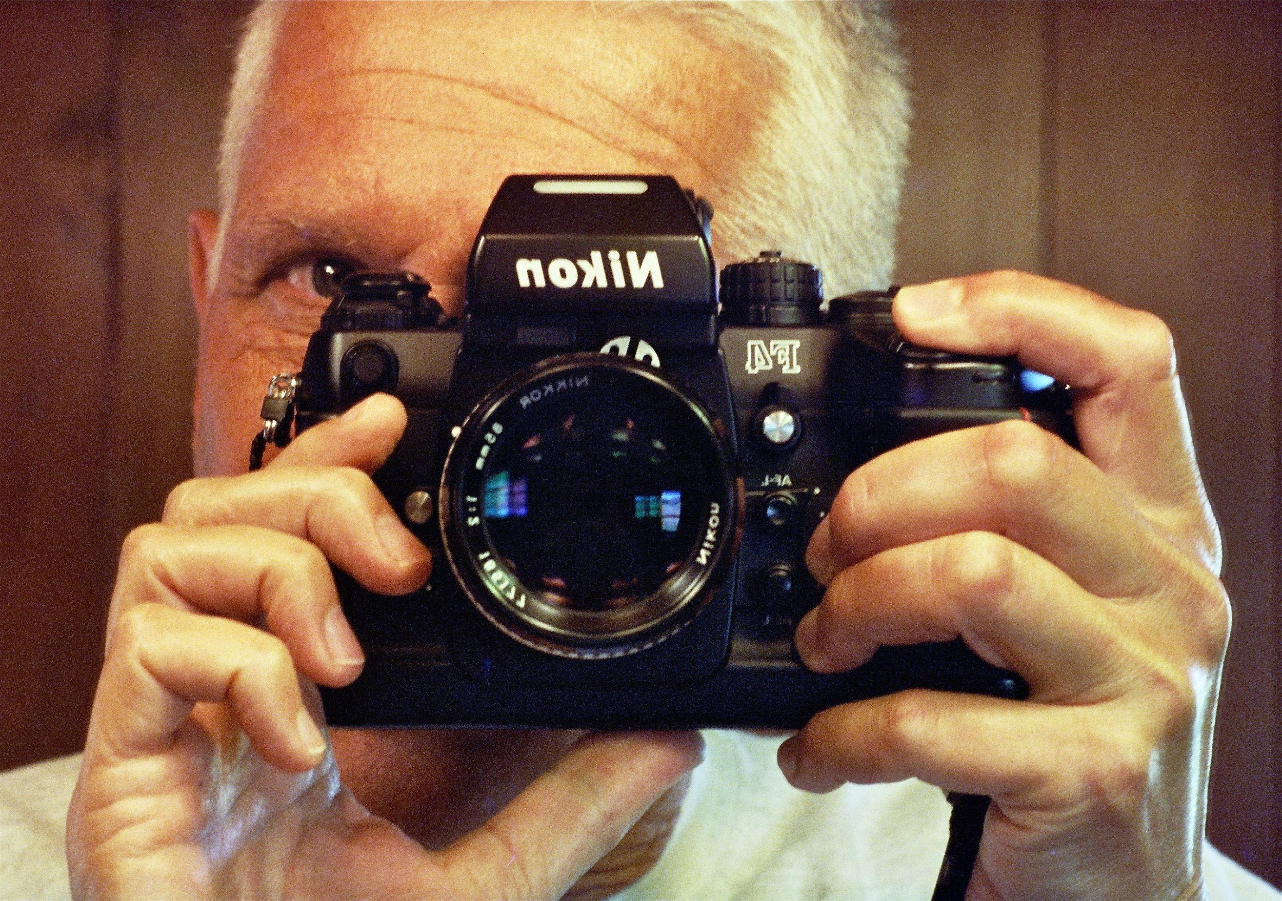 The author, his F4, shot on Kodak's CineStill 800T