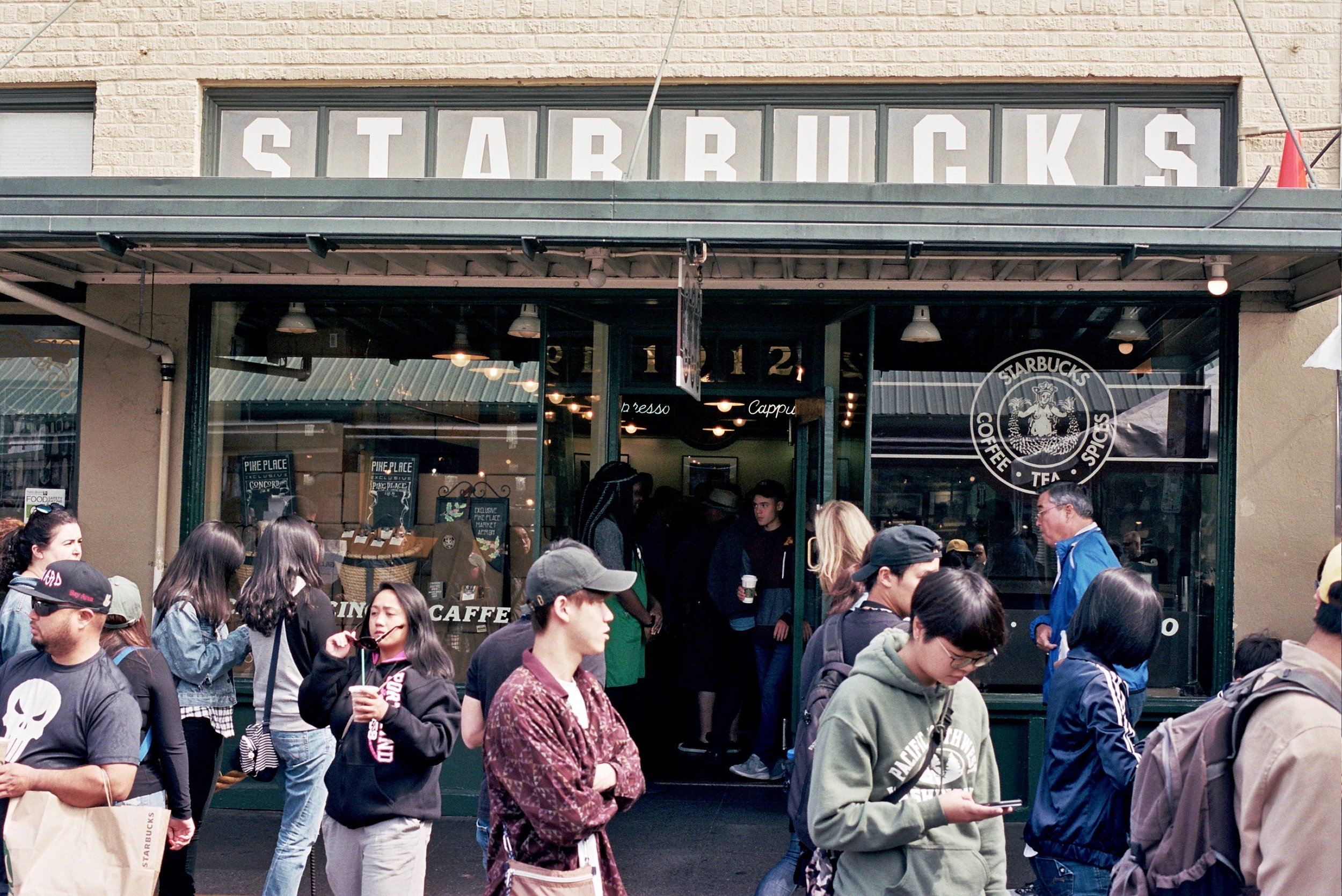 The very first Starbucks at the Seattle Public Market. The line went around the block.
