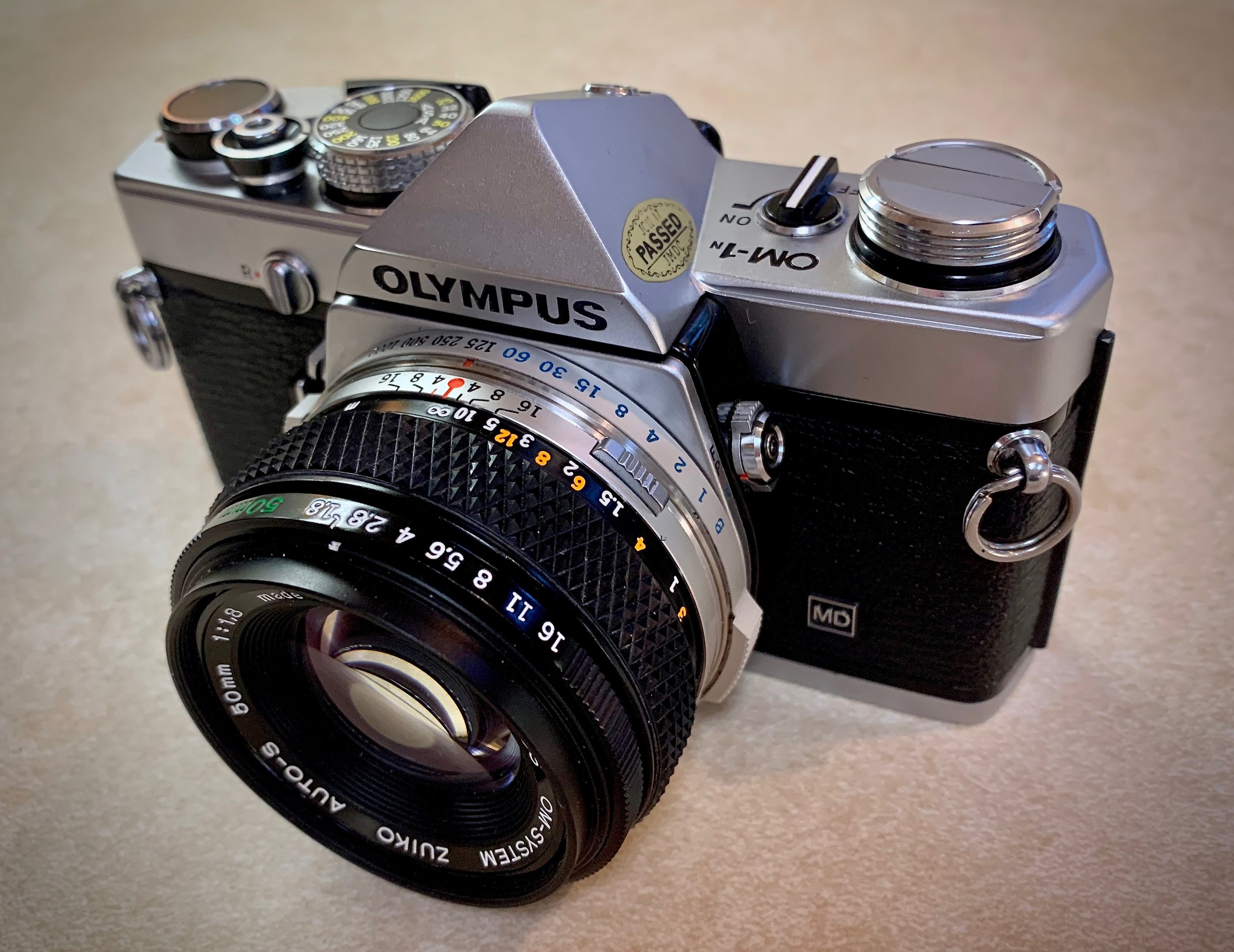 Olympus OM-1n fitted with the 50mm f/1.8 Zuiko kit lens