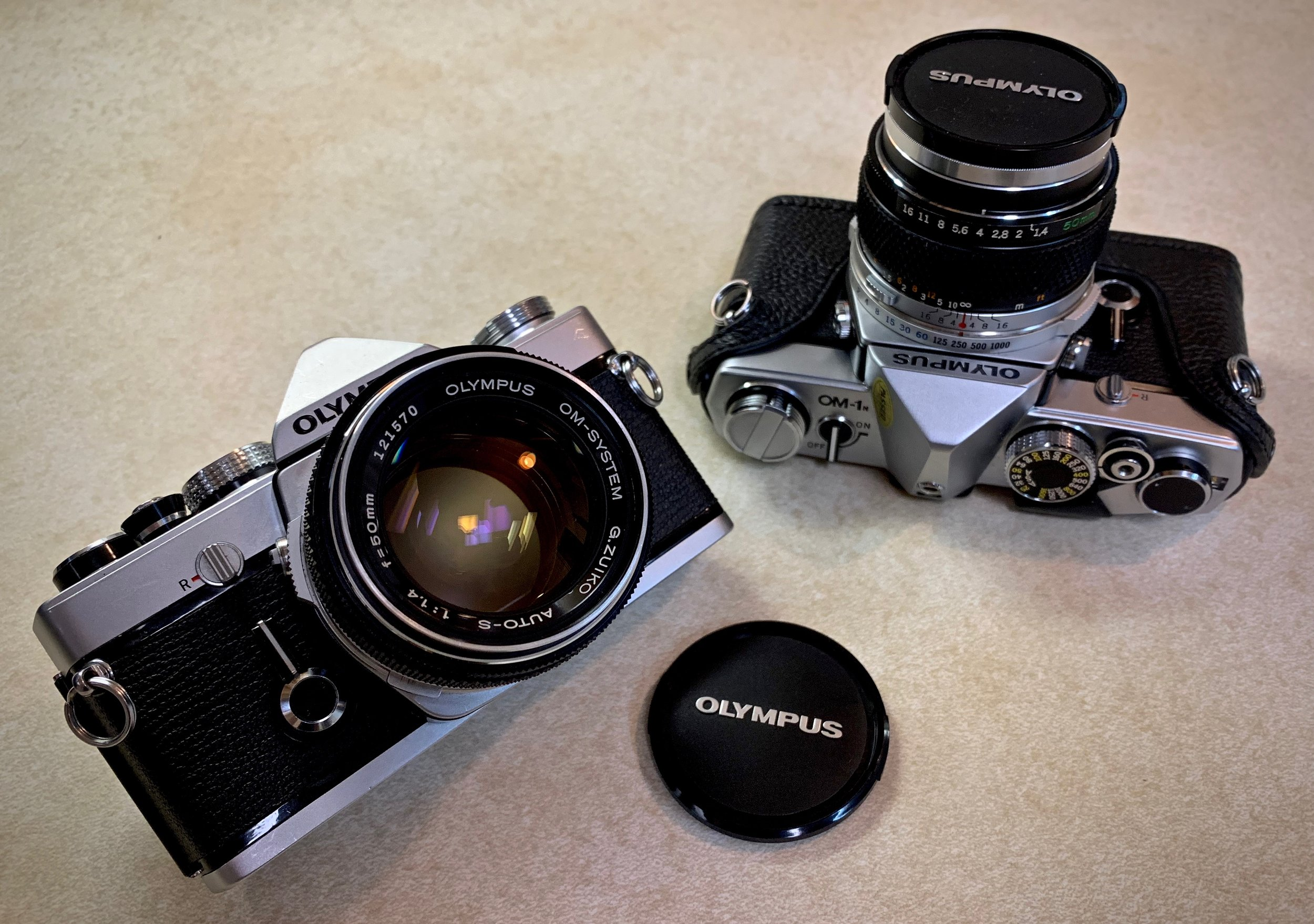 Olympus OM-1 - Olympus turned heads in 1972 when they introduced the little OM-1. Exceptional build quality and amazing Zuiko lenses make the OM-1 and 1979's OM-1n must try mechanical cameras. Affordable adapters make batteries a non issue or have it CLA'd and converted to 1.5v.
