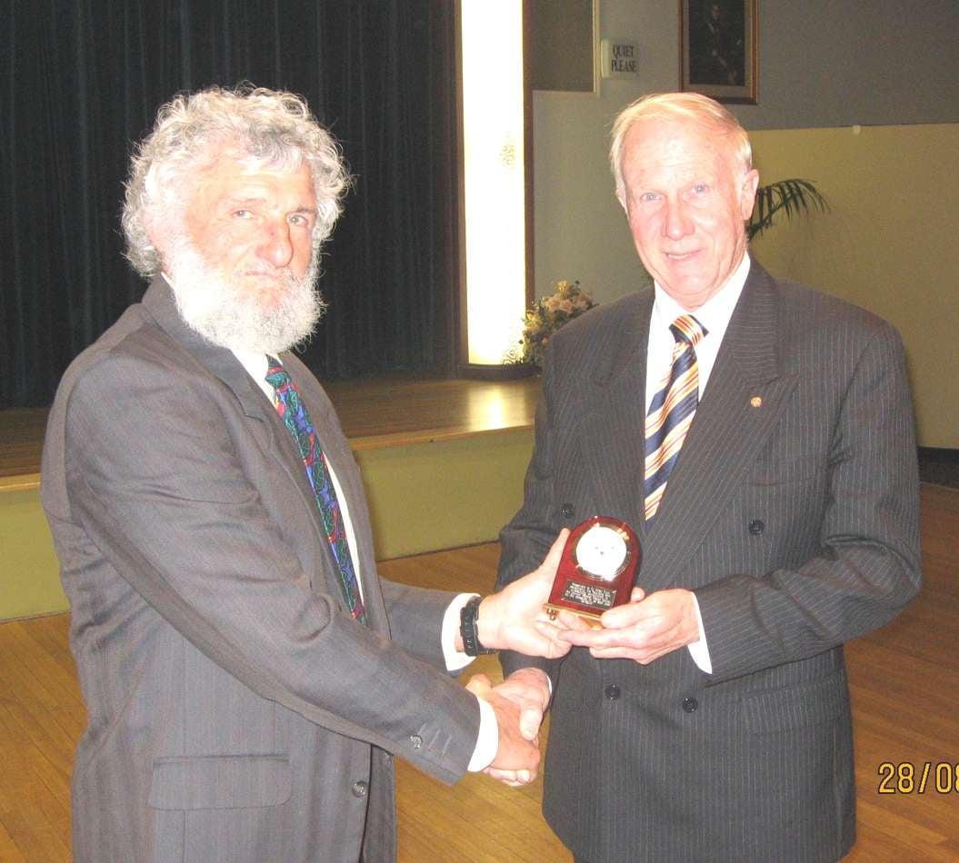 Brian Rensford presenting an award to Allan Ezzy in 2011