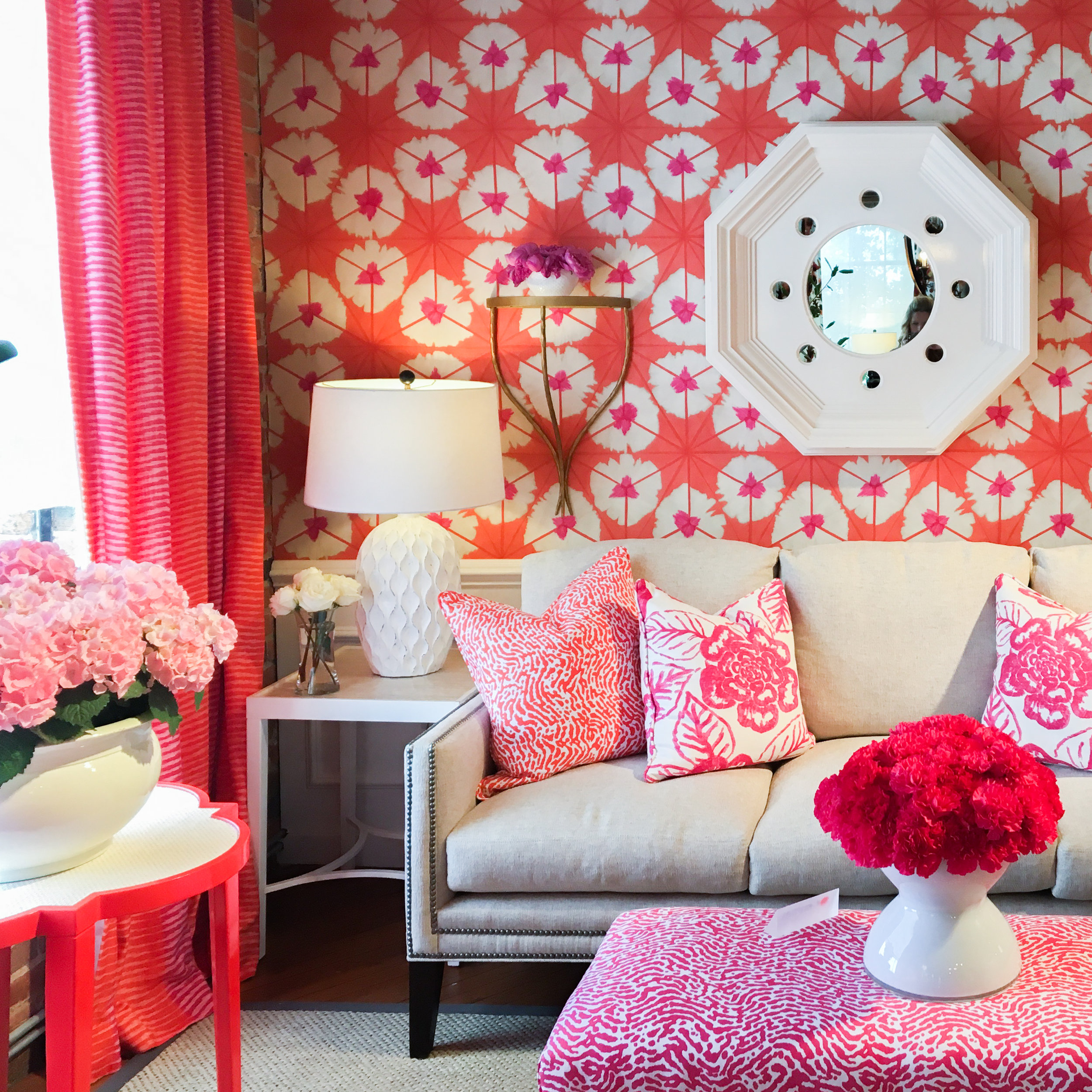 Thibaut's  use of color and pattern is inspiring. Reds, oranges and pinks look sophisticated in this living room design.
