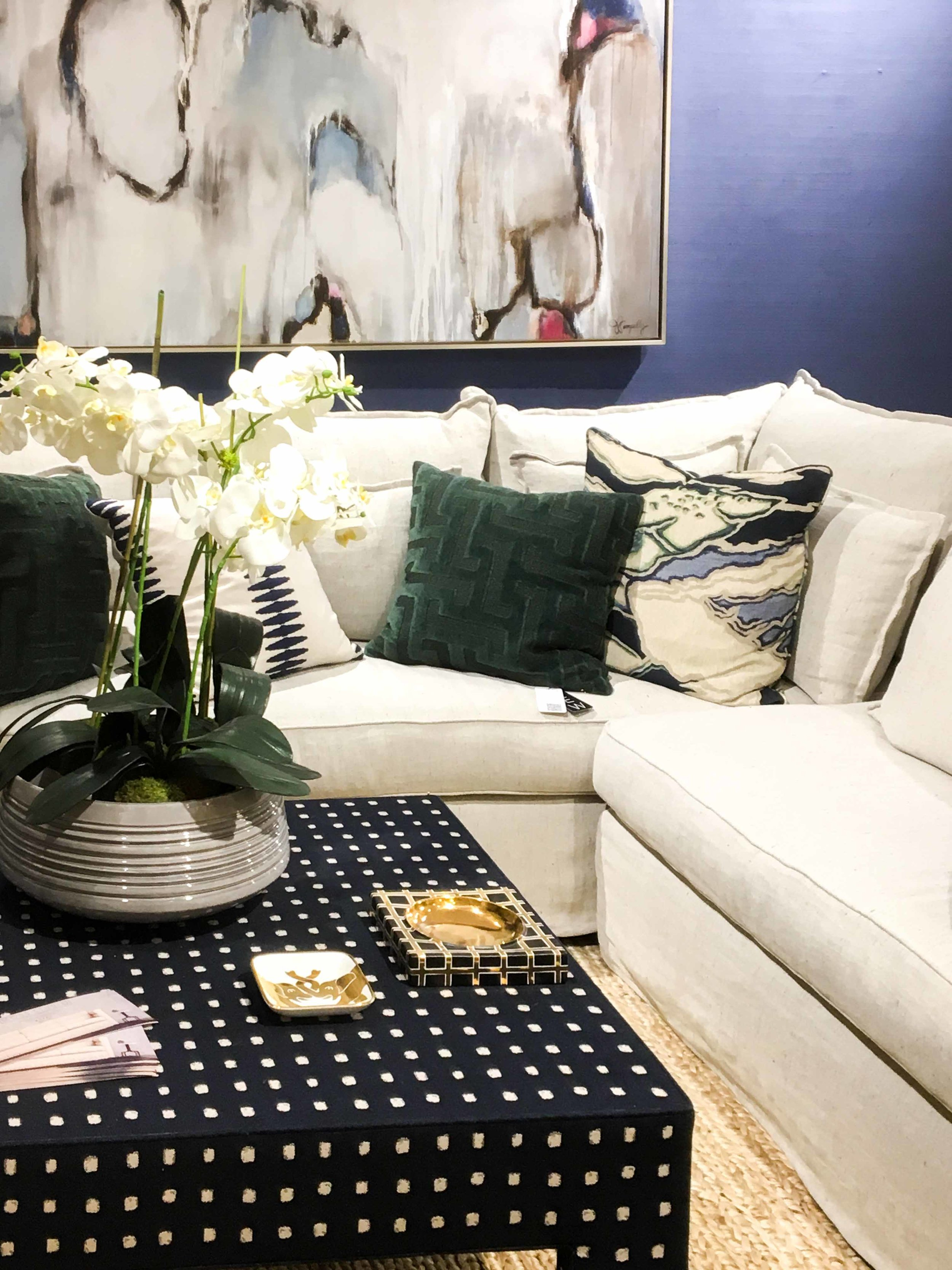 Mary McDonald for Chaddock . Her mix of navy and dark green with light neutral furniture and rugs keeps things interesting without being too colorful.