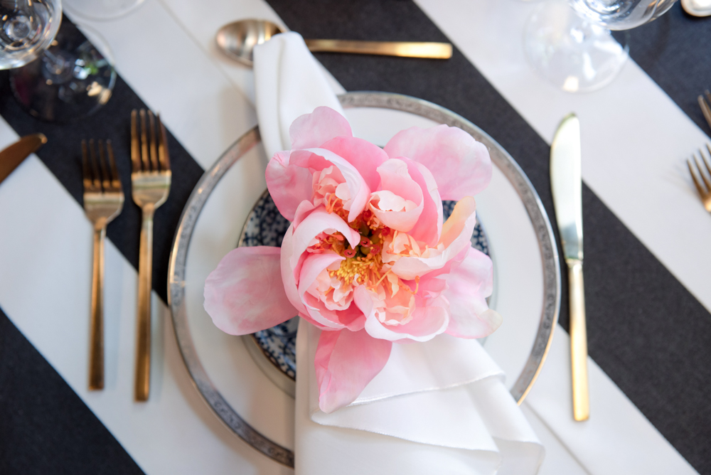 We turned beautiful blooms into napkin rings to make each place setting lovely and unique.