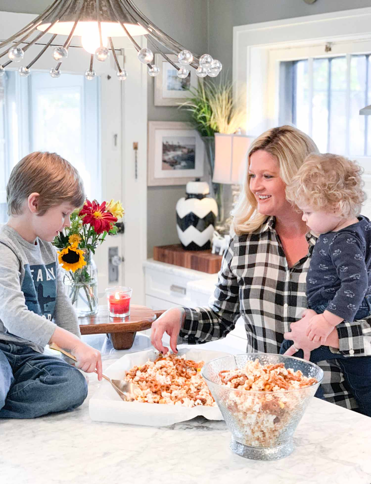 This week we made a candy coated popcorn and pretzel treat together. Having a large island really does make a difference in how our family uses a kitchen.