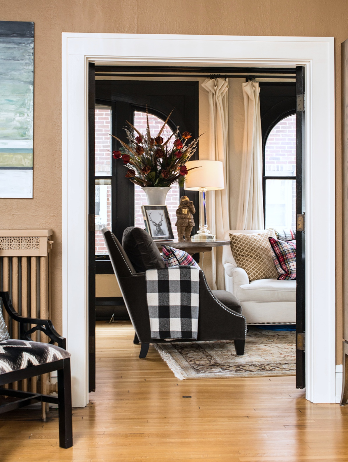 Incorporating plaids and buffalo check fabrics gives the more formal space a cozier feeling.