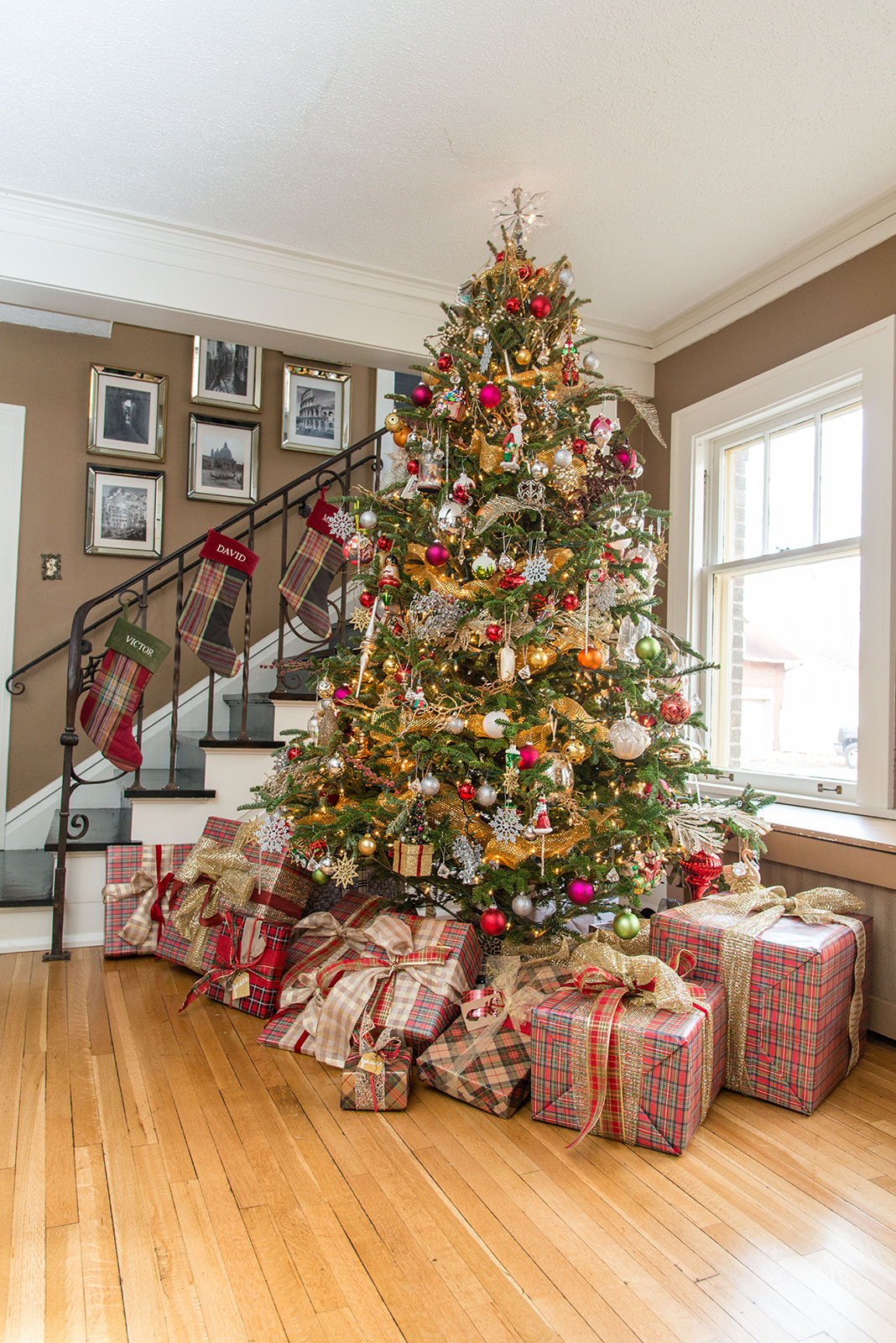 A color palette of red and gold, glass ornaments, plenty of ribbon and a bit of electric flare our tree gives our tree the perfect balance of formal and fun.