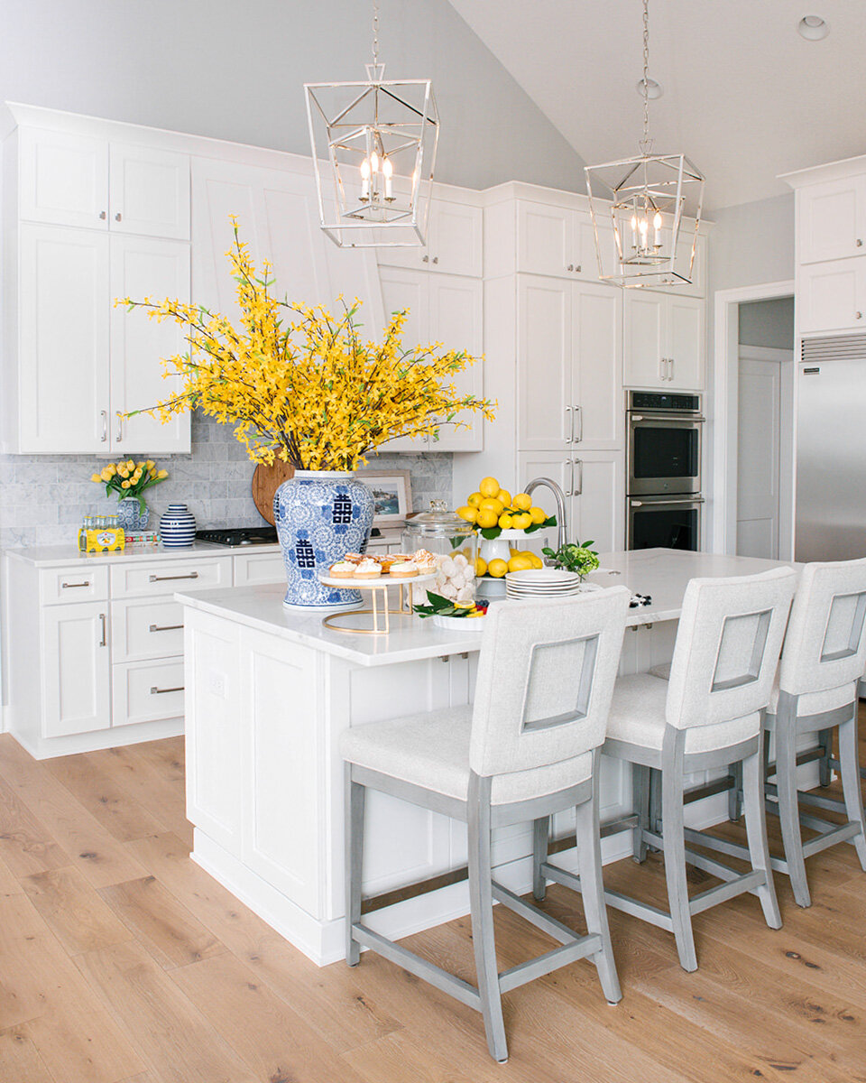 These incredible stools have the perfect updated traditional feel for this open-concept kitchen. They have a timeless design, comfortable seat and an inset design that sets them apart from what can be bought retail.