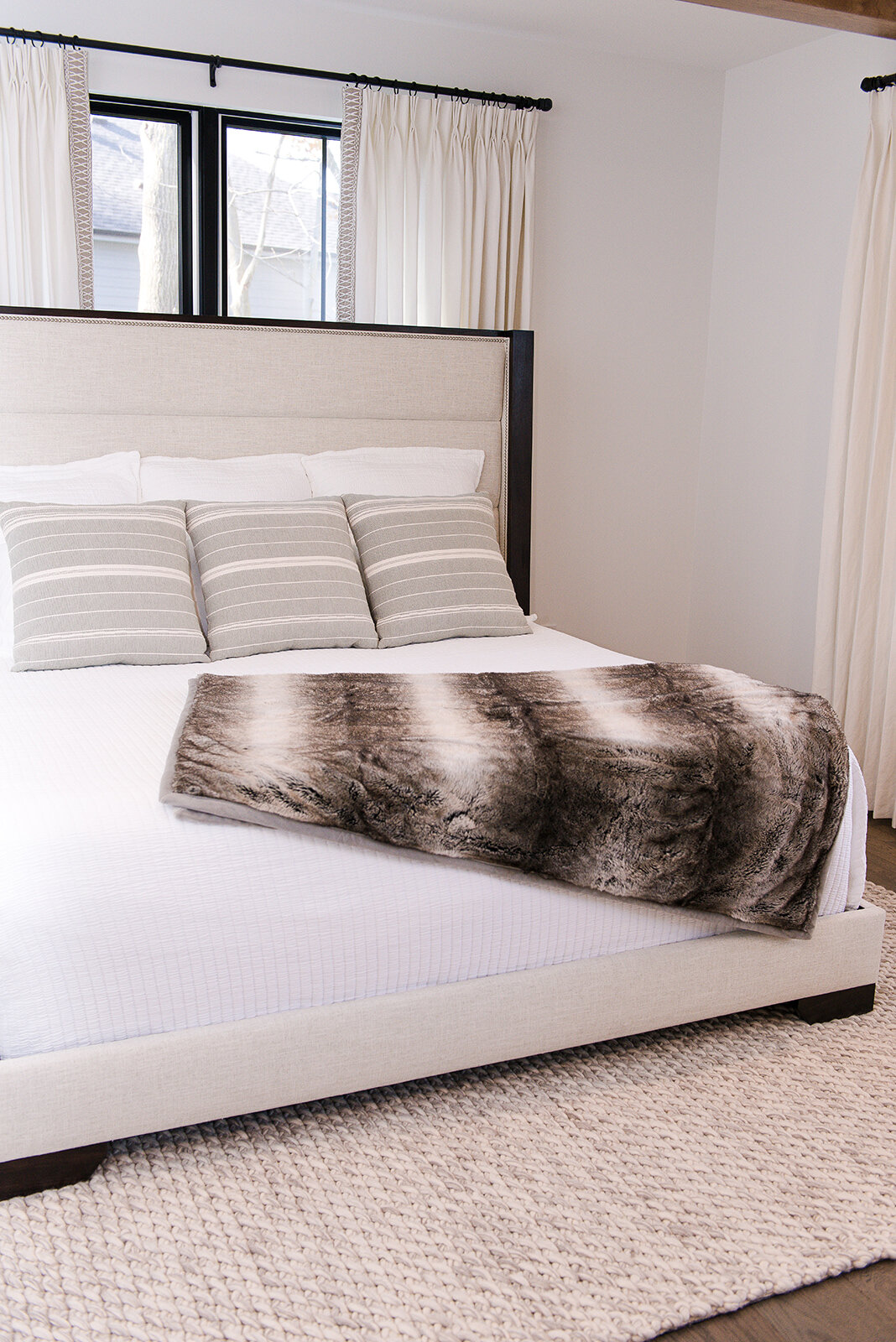 We chose this Vanguard upholstered bed for our modern farmhouse project and could not love it more for the space. It is full of comfort while giving a sleek line to the master bedroom.