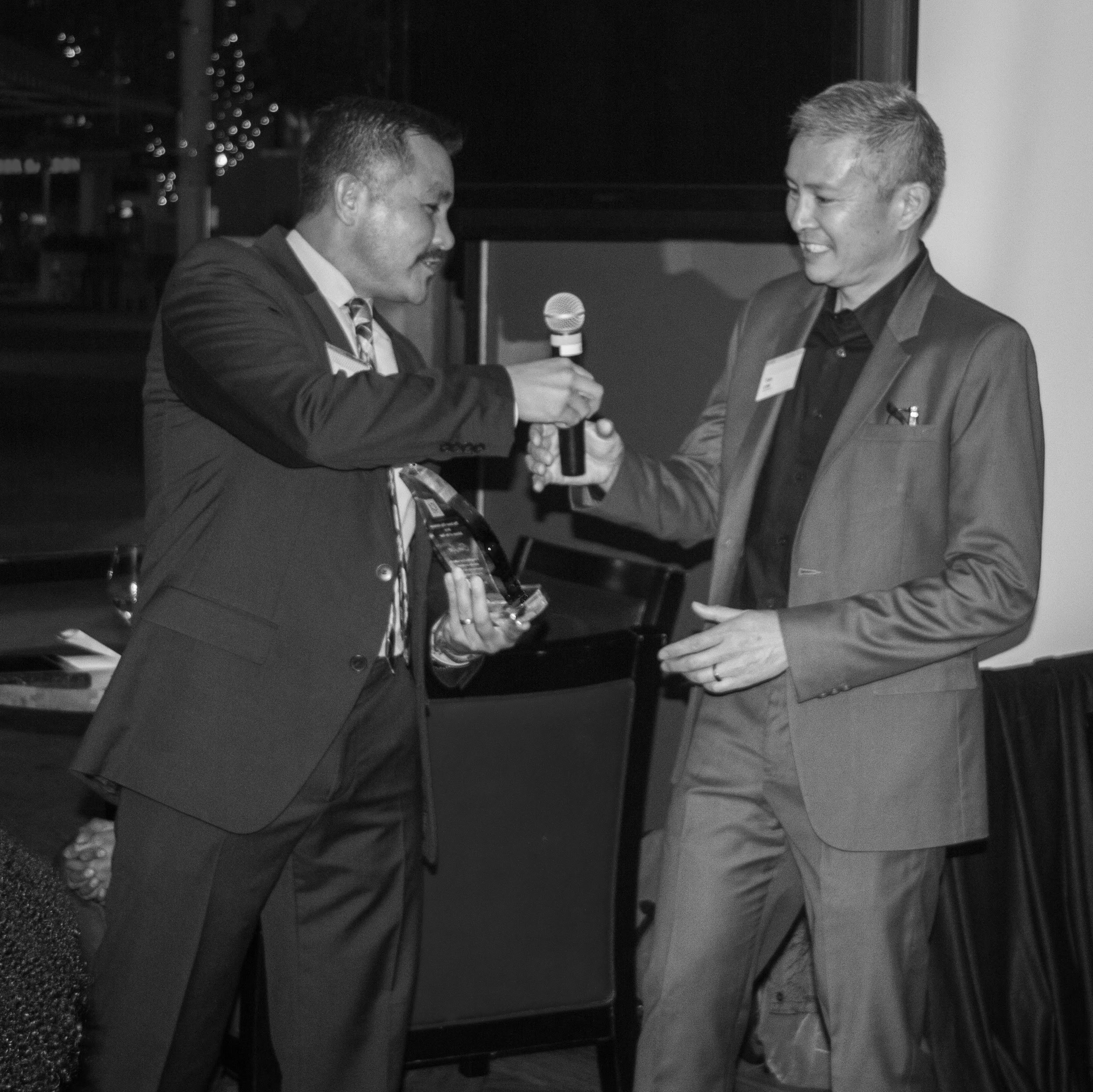 Tom was named 2014 Advisor of the Year by Inner City Advisors, which recognized him for his volunteer work with their portfolio companies. Jose Corona, CEO of ICA is on the left.    Photo by    Kelly McCann Photography   .