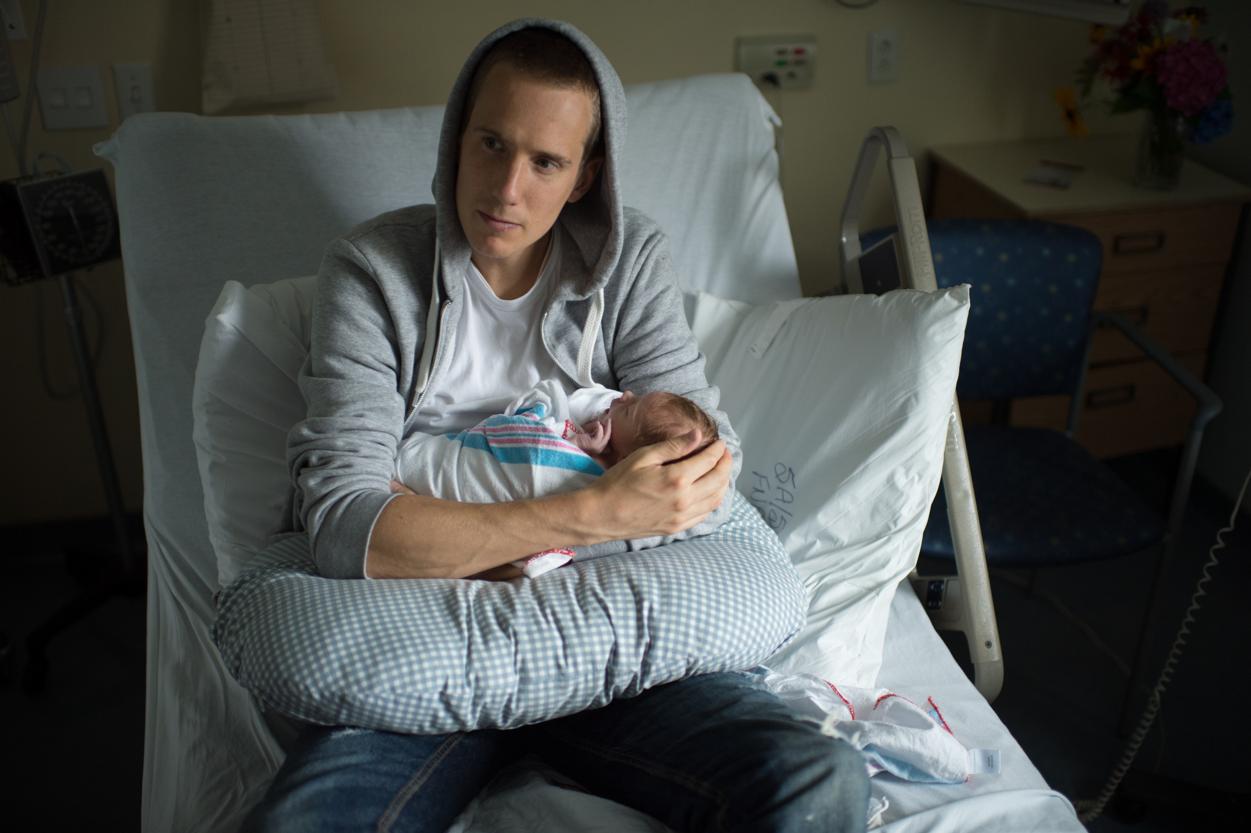 Layton and his new born son Finn. Photo credit:  Jeff Cooke