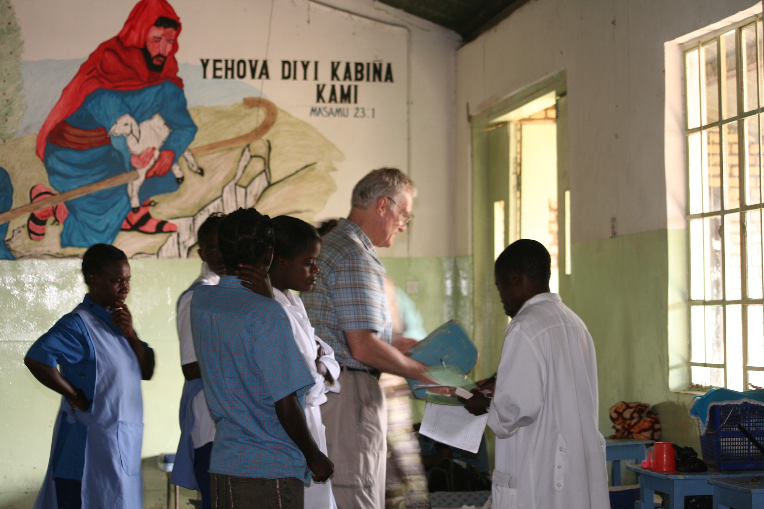 THE GOOD DOCTOR: Welsh expatriate Dr. Davies makes his daily rounds at Kalene Mission Hospital.