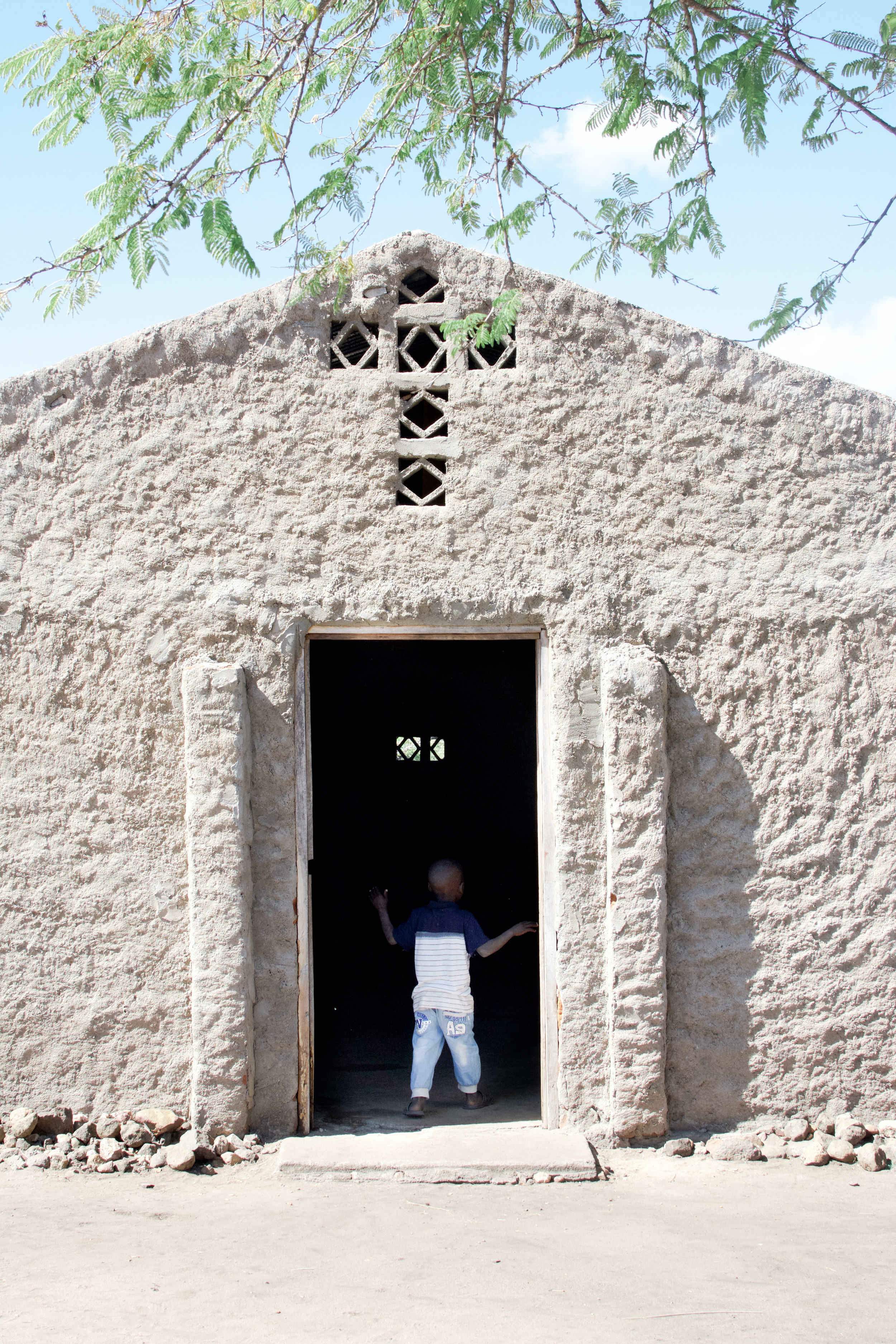 A young boy looks into the church building of St. Matthews Lutheran Church in Kapesseni.