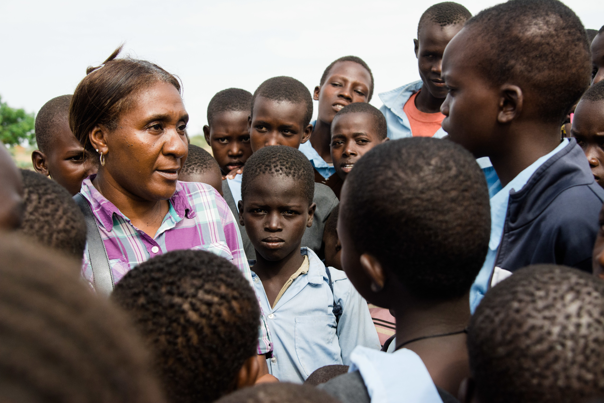 Career missionary Shara Cunningham talks to the children playing around the clinic site.