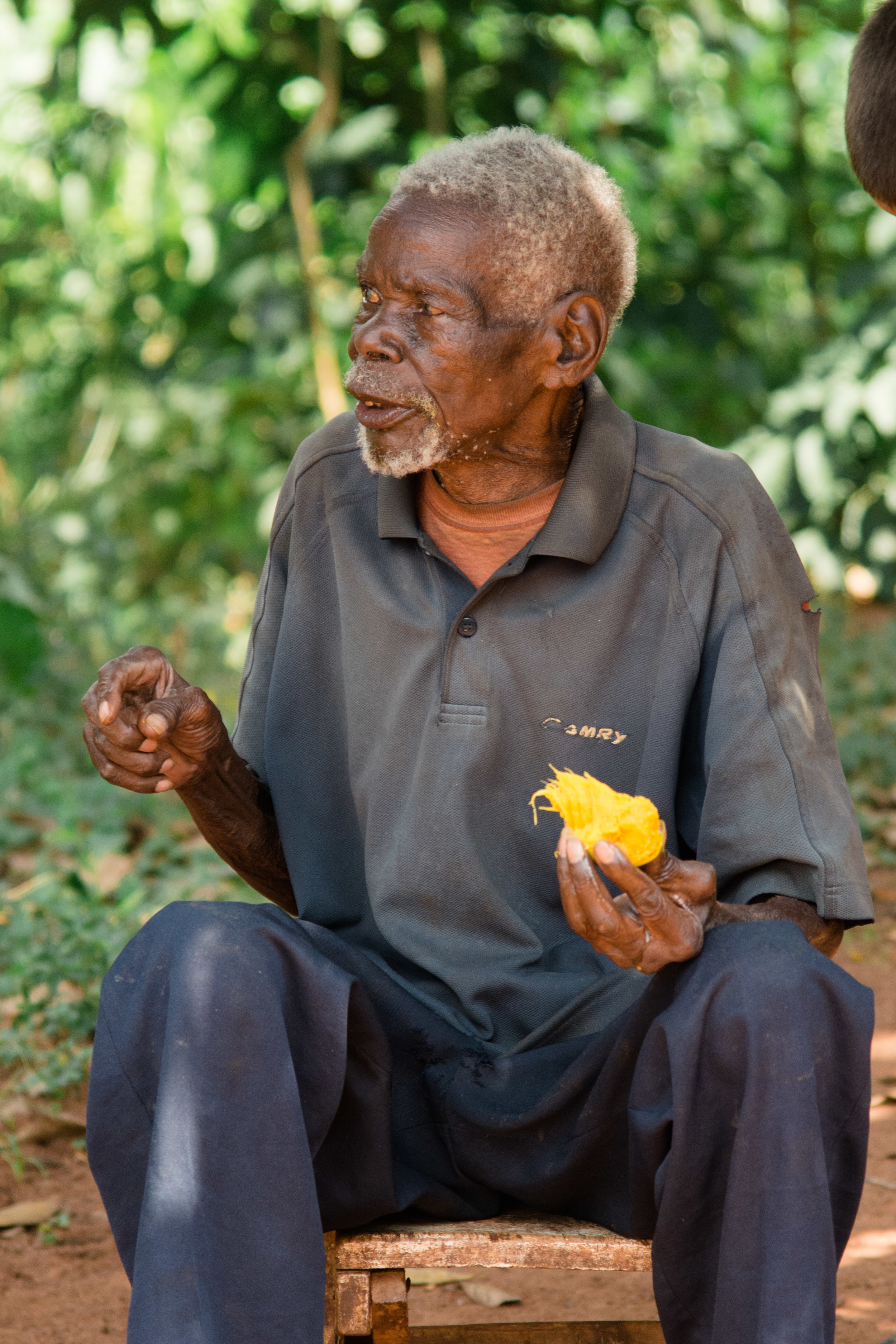 Eating a mango on a hot afternoon