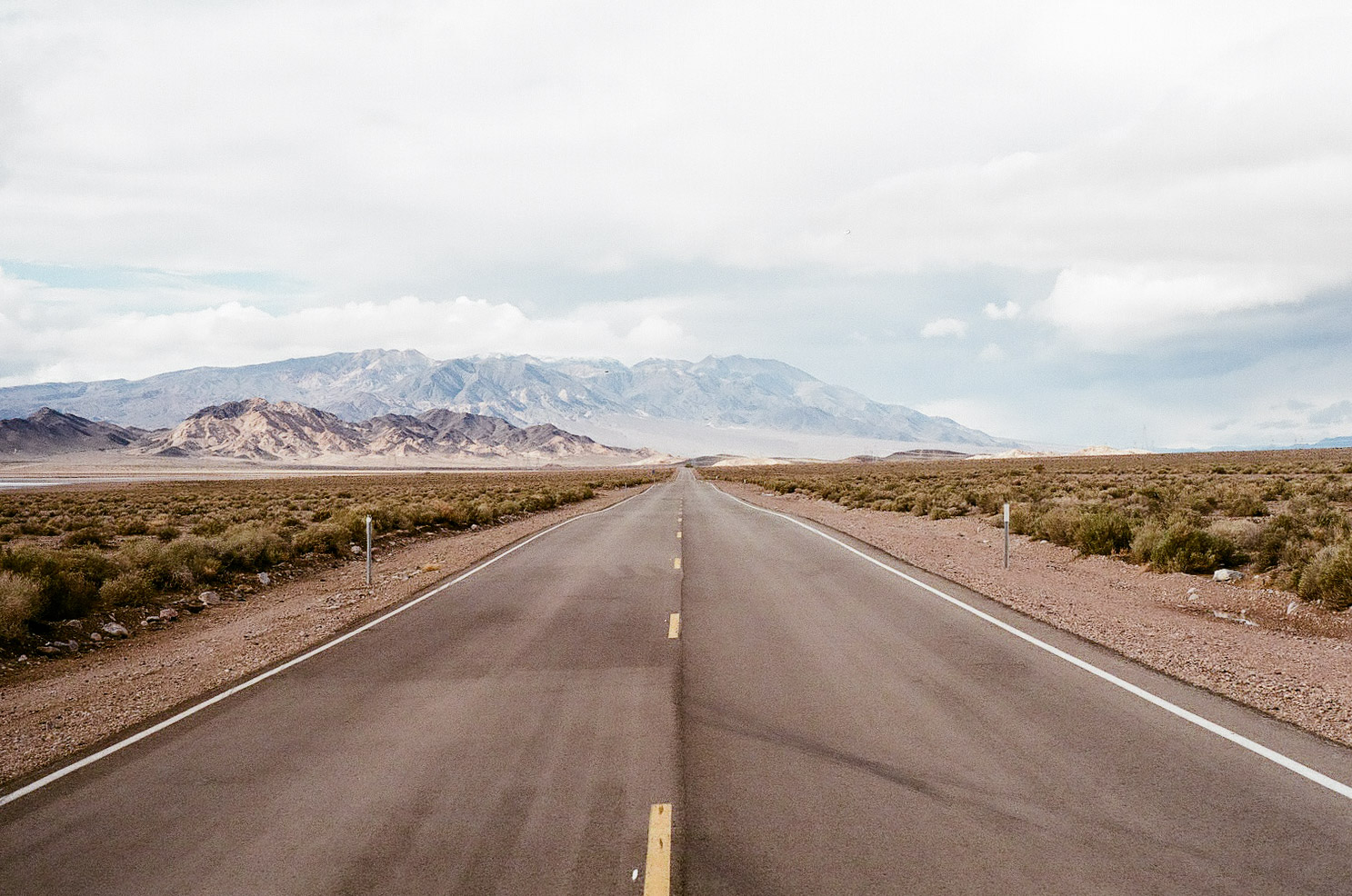 Coming into Death Valley, the land is harsh and colored in a mostly monochromatic, earthen palette. It's hard to imagine what the desolate landscape would be like in oppressive, dangerous July heat.