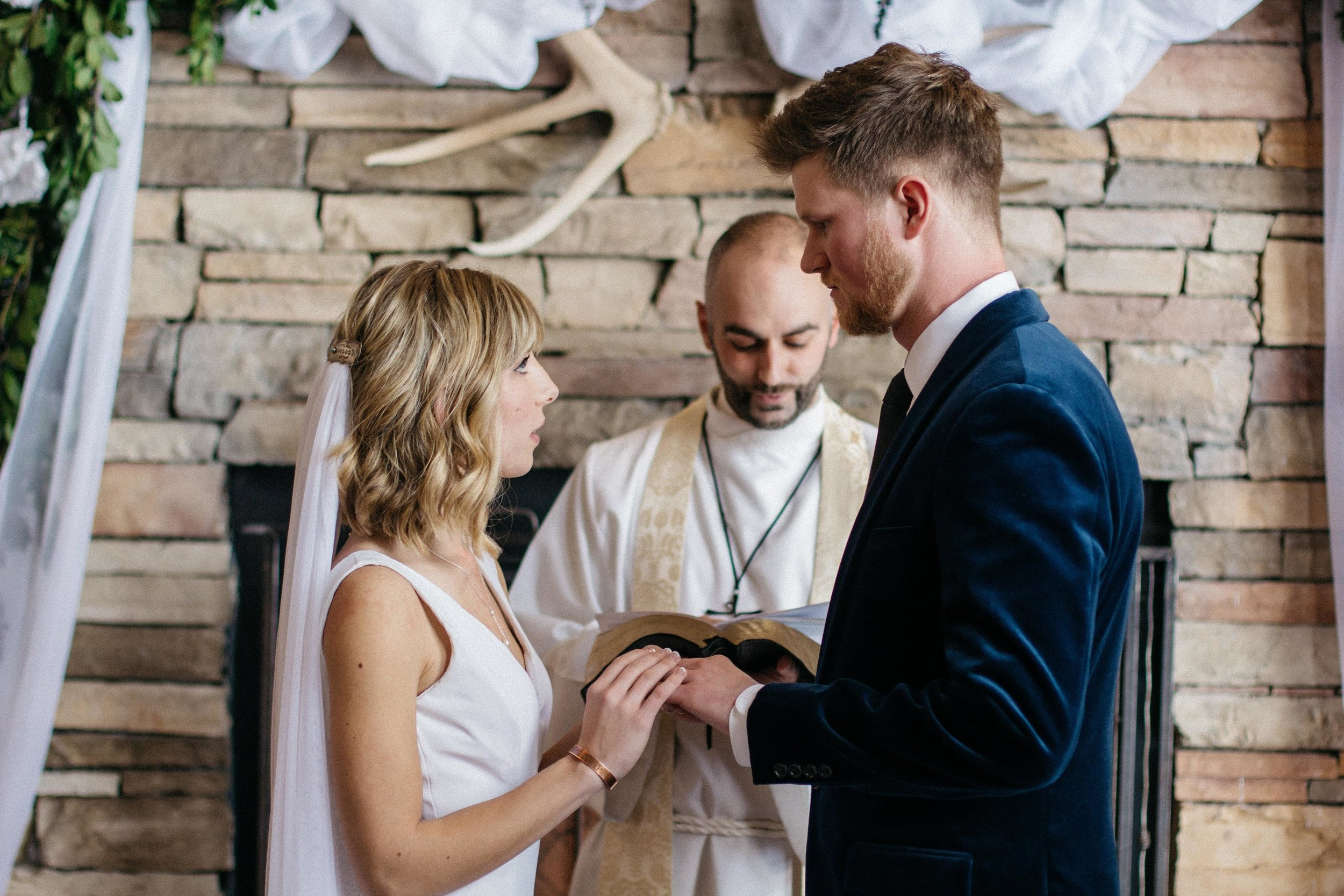 Saying our vows were some of the longest, most intense seconds of my life. We chose to rely on the liturgy rather than write our own vows, and in the moment I was so glad--I didn't know how couples could manage to say, let alone write, their vows without breaking down!