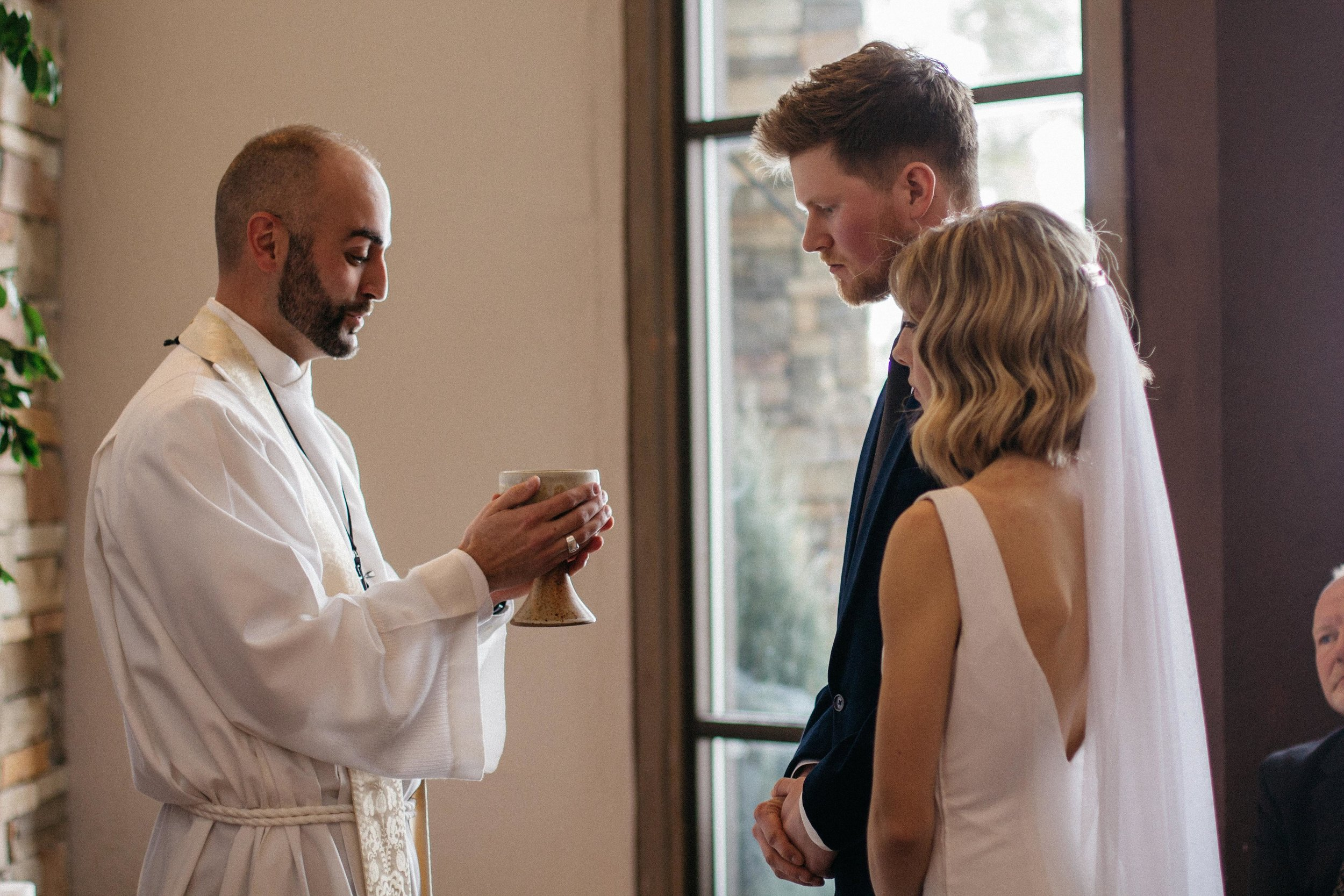 Towards the end of the ceremony, we had communion for the first time as husband and wife to the  most beautiful song  by Sufjan Stevens.