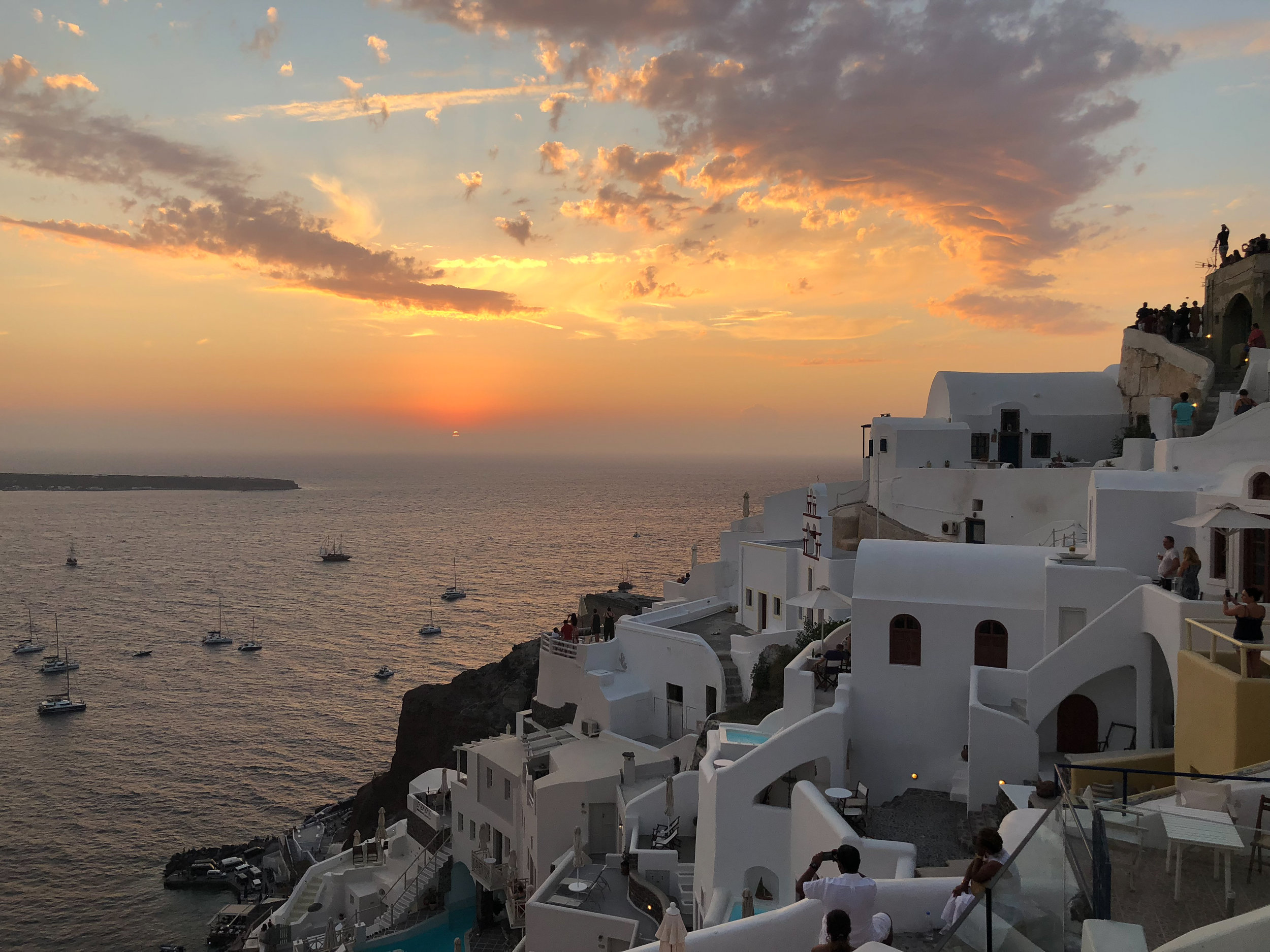 The sunset along the caldera in Oia