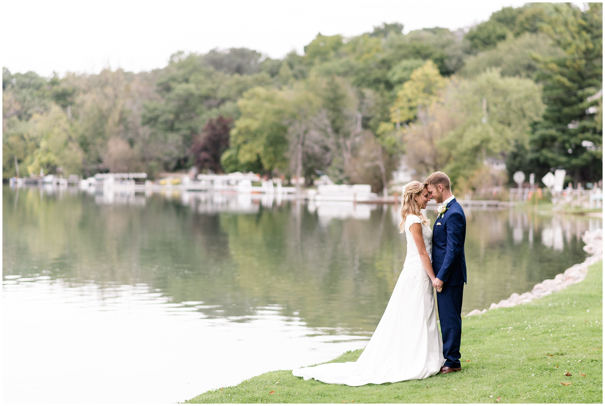 bride and groom on their wedding day at Booth Lake in East Troy Wisconsin
