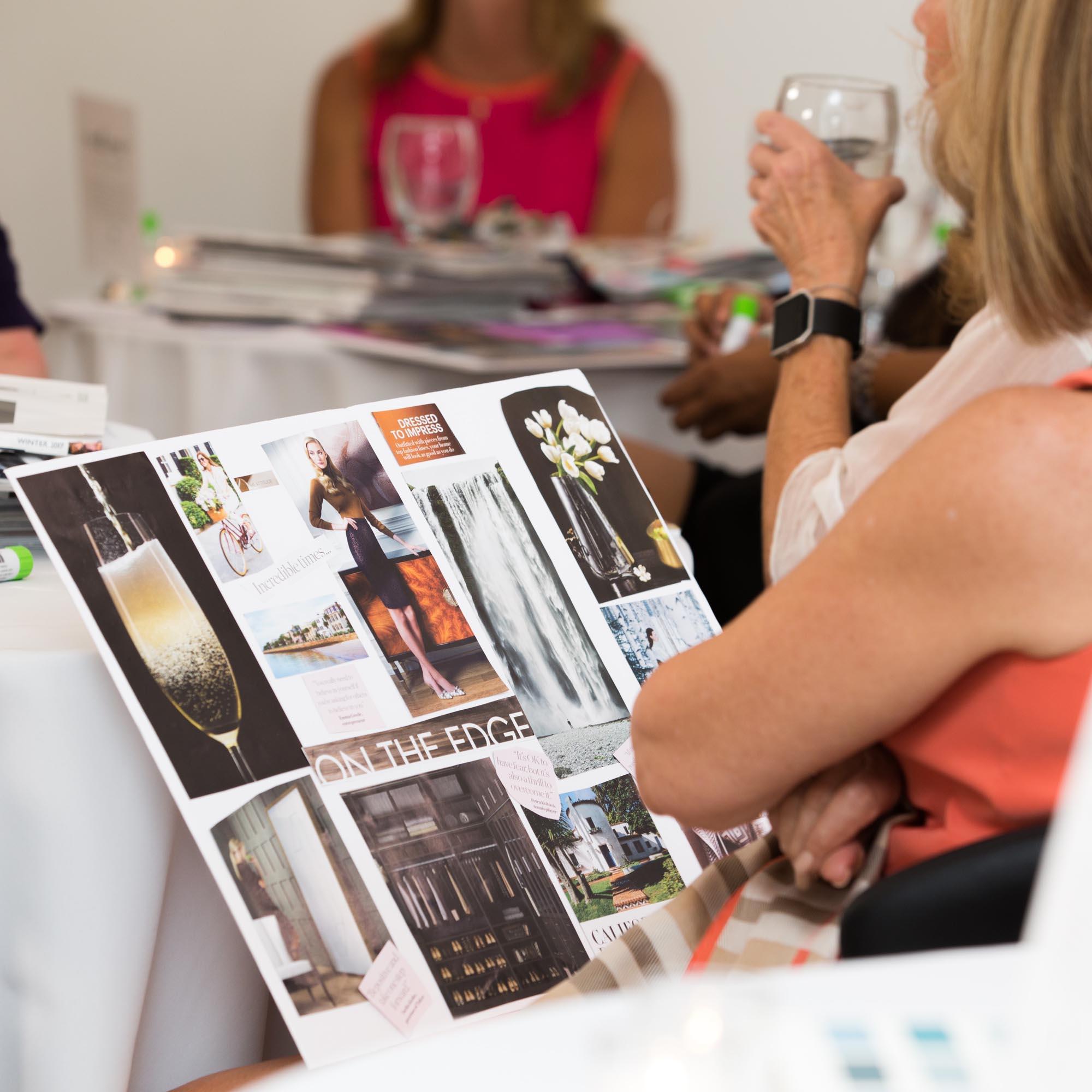 woman looking at mood boards in a branding workshop