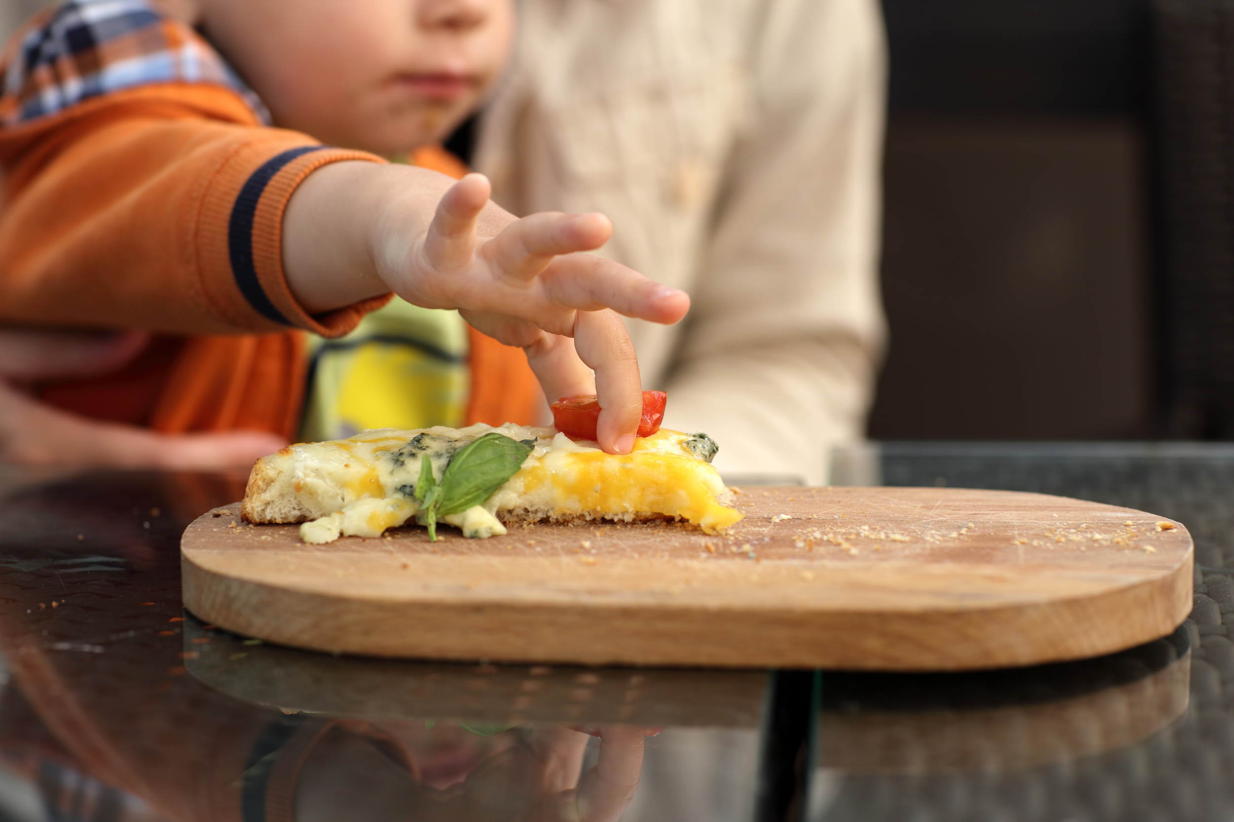 bigstock-Toddler-Takes-Slice-Of-Tomato-47887115