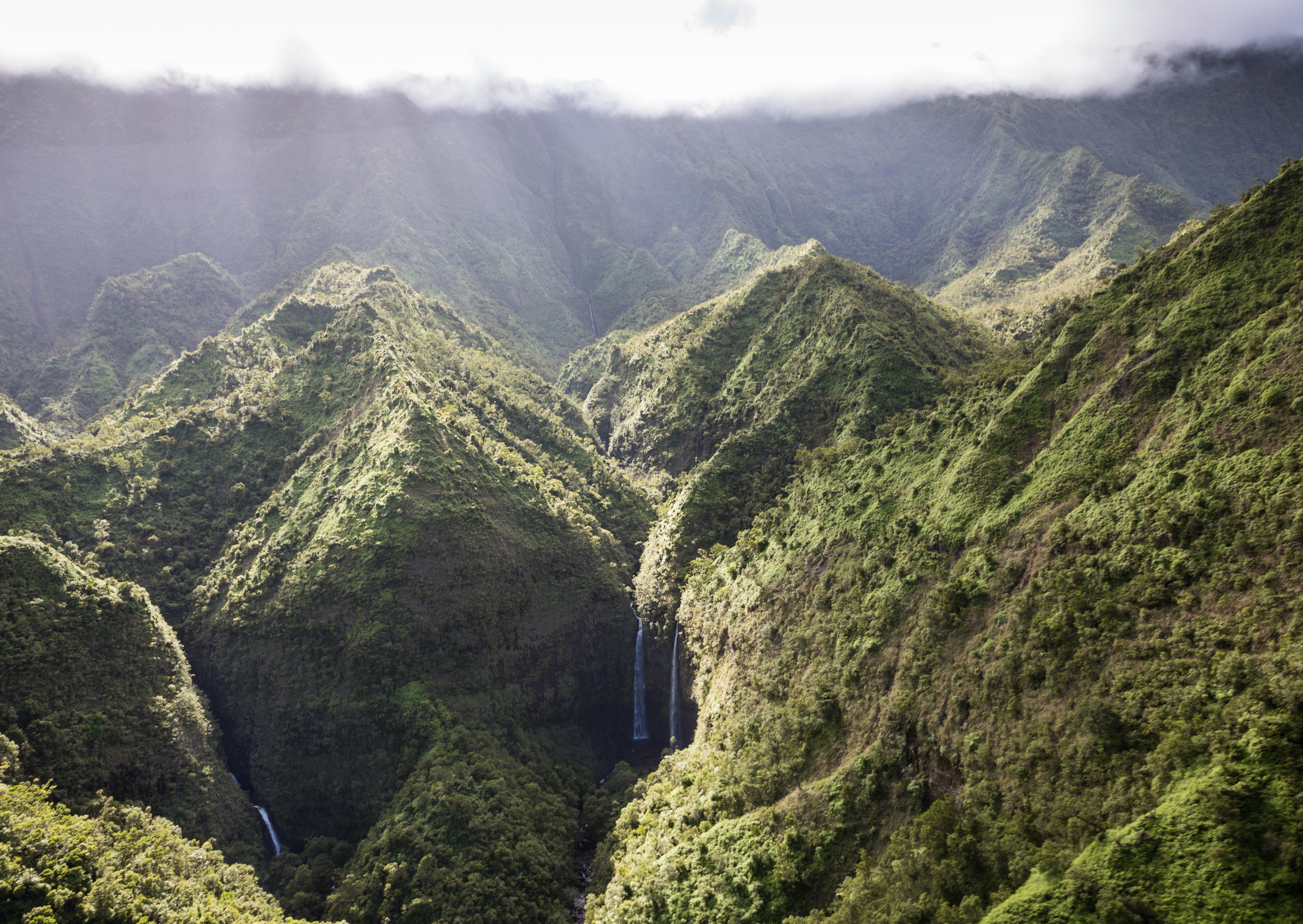 the national parks girl_Kauai_hawaii_canon6d_jack harter helicopter ride_doors off heli ride_jurassic park_waterfall.JPG