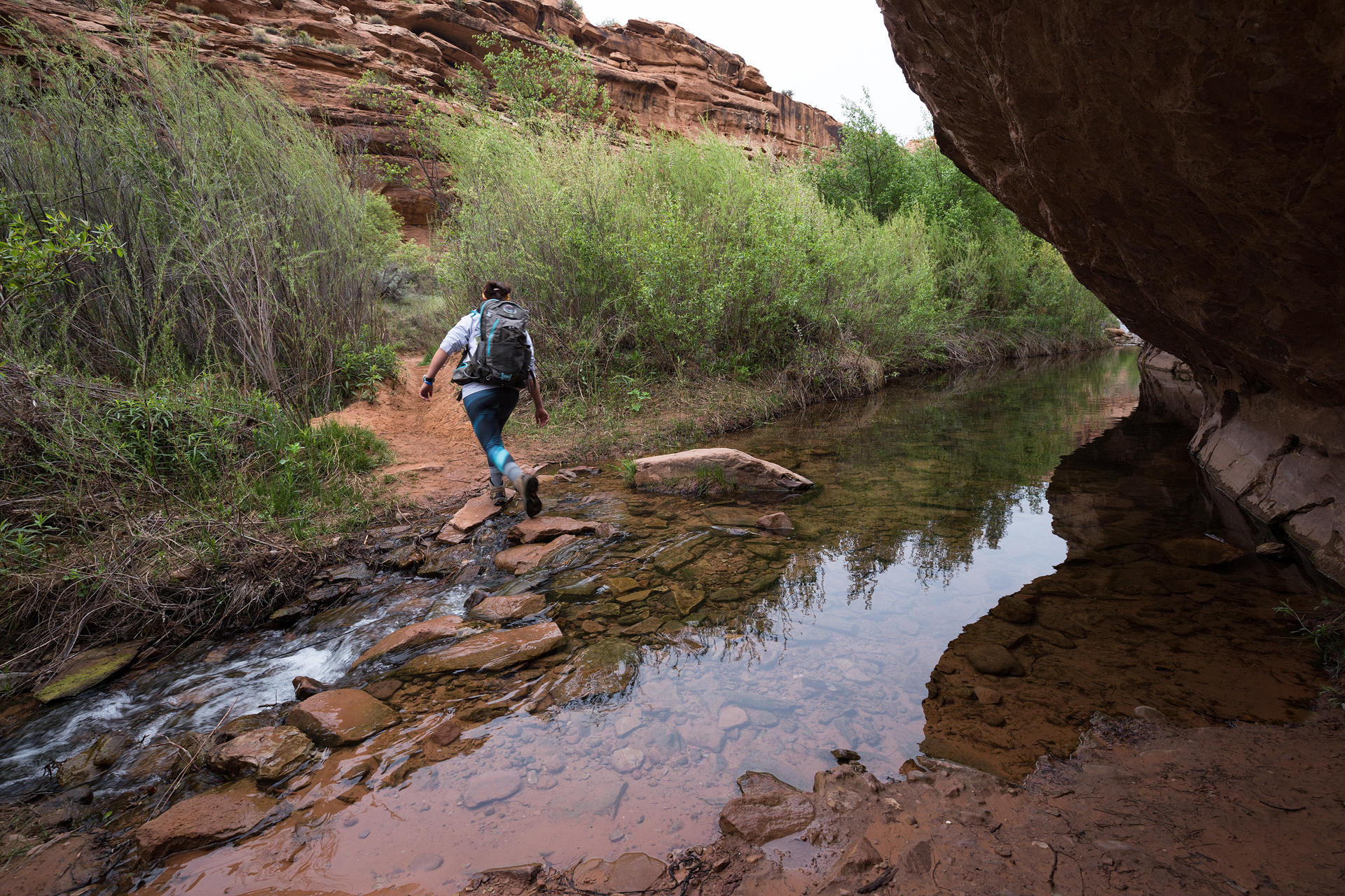 Christina crossing one of the many streams on the hike to Negro Bill Canyon