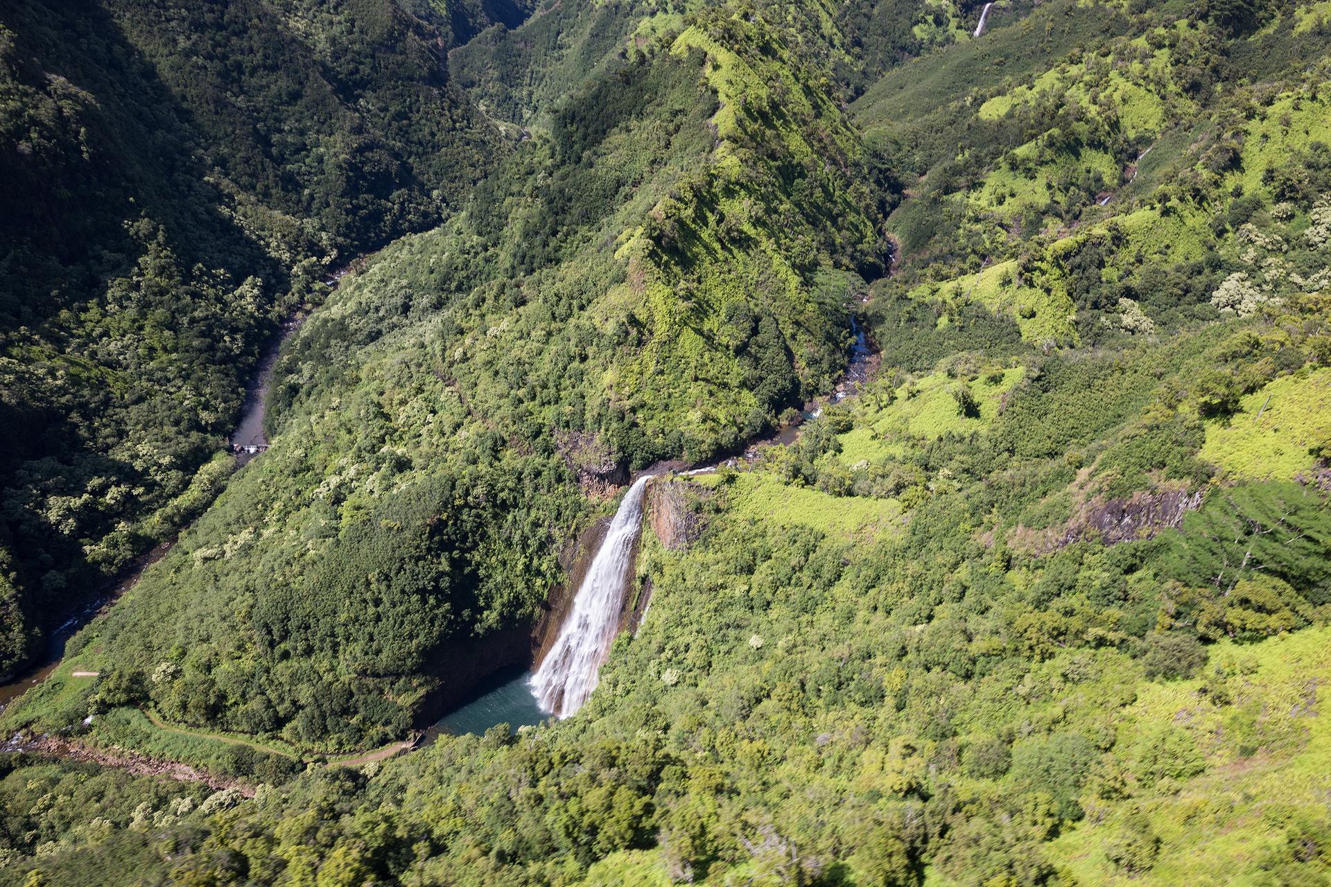 the national parks girl_Kauai_Jack Harter_doors off heli ride_waterfall_napali coast_hawaii_jurassic park_canon6d.JPG