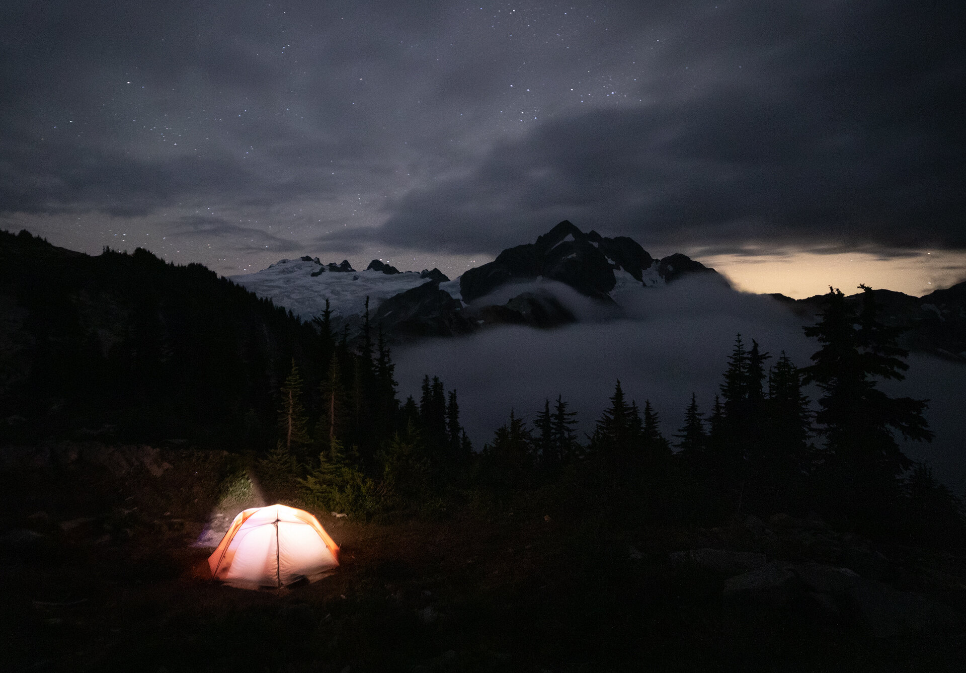 Our camp at night, with Mount Challenger and Whatcom Peak in the background