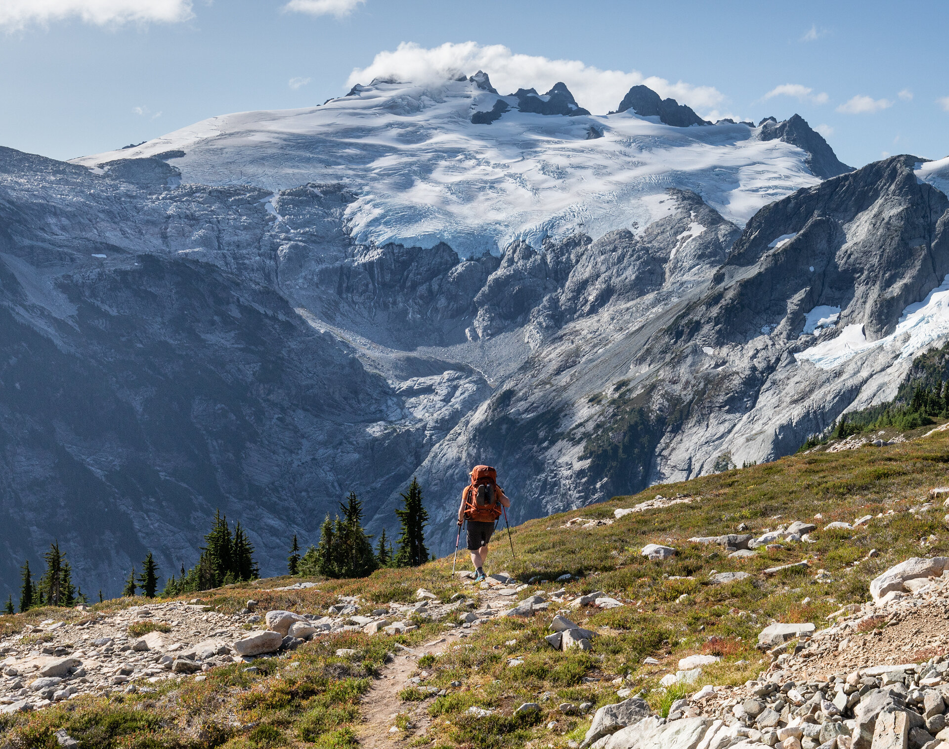Alex descending toward Whatcom Pass with Mount Challenger in the background