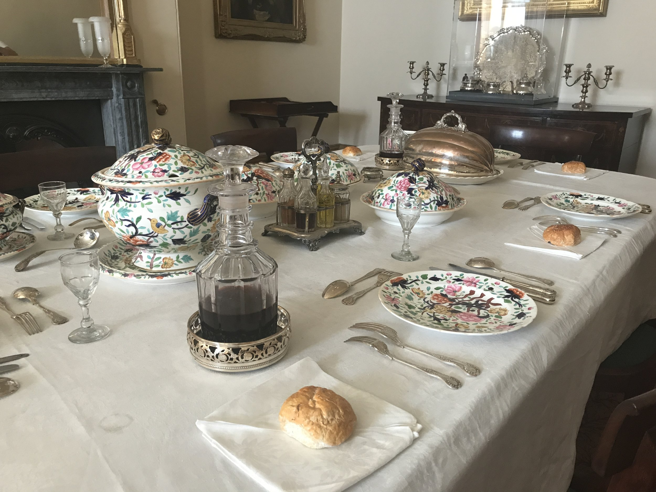 The dining table, laid out in Victorian elegance
