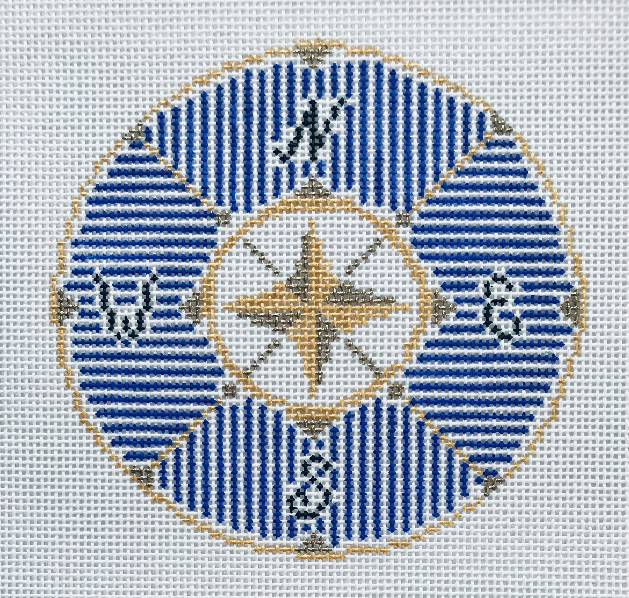 "Compass in Blue 18KK-B   4"" round on 18 mesh"