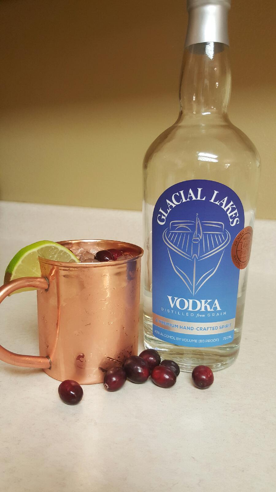 1.5 oz GLACIAL LAKES VODKA   1.5 oz cRANBERRY jUICE   fILL WITH CRANBERRY GINGER BEER   SPLASH OF lIME jUICE   GARNISH WITH fRESH OR FROZEN CRANBERRIES   sERVE ON CRUSHED ICE
