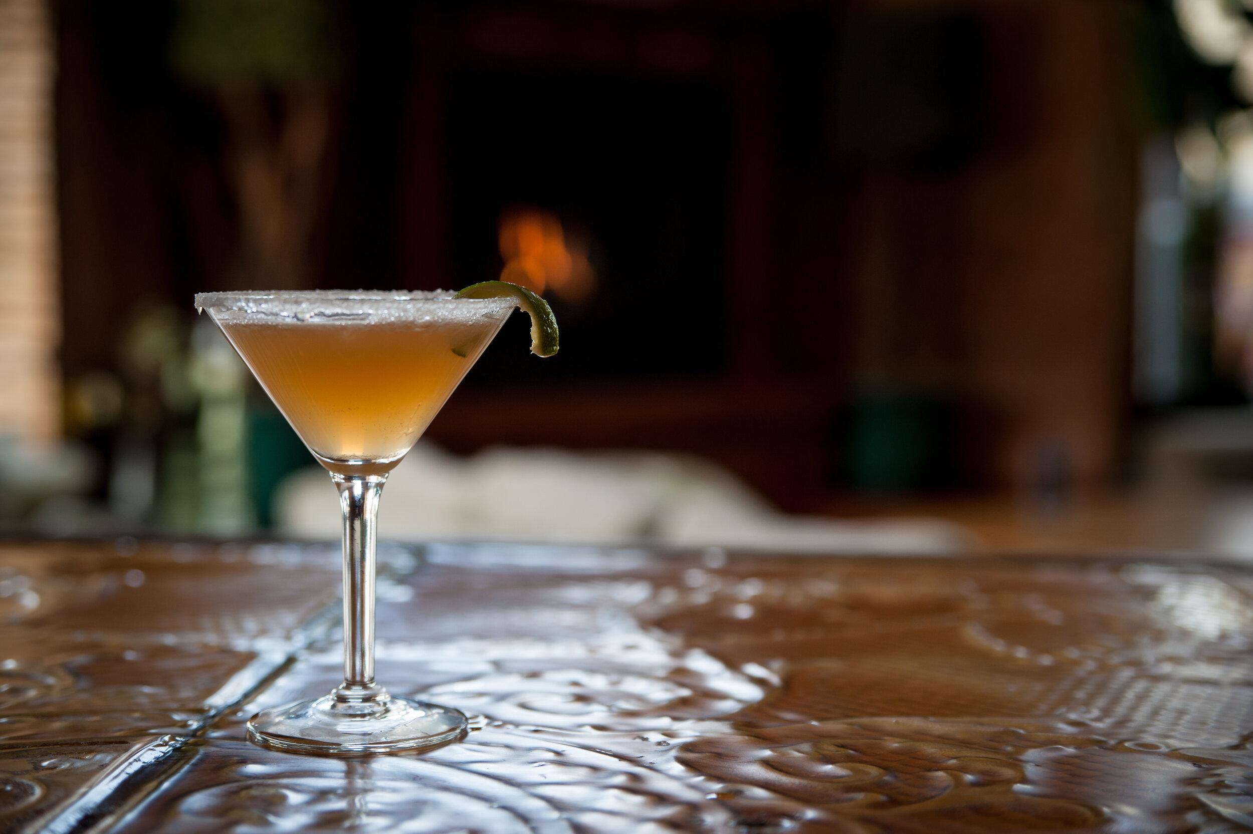 Between the sheets - 1 oz Courvoisier Cognac1 oz Whitecap rum1 oz lemon.5 oz Grand Marnier.5 oz simple syrupDash of orange bittersServe in a chilled martini glassSugar rim garnish