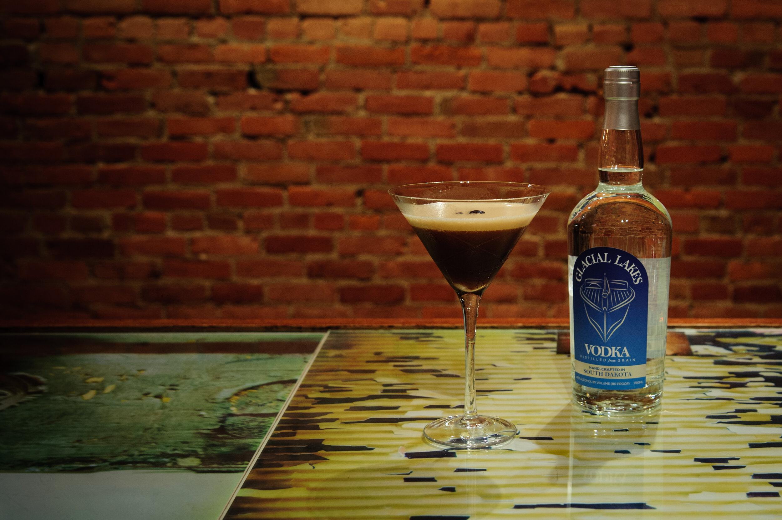 Espresso martini - 1.5 oz Glacial Lakes Vodka1/2 oz Wooden Boat Rum1 oz of espresso3 drops chocolate bitters3 drops vanilla1/4 oz simple syrupShake vigorouslyServe in a chilled martini glassfloat 3 coffee beans garnish