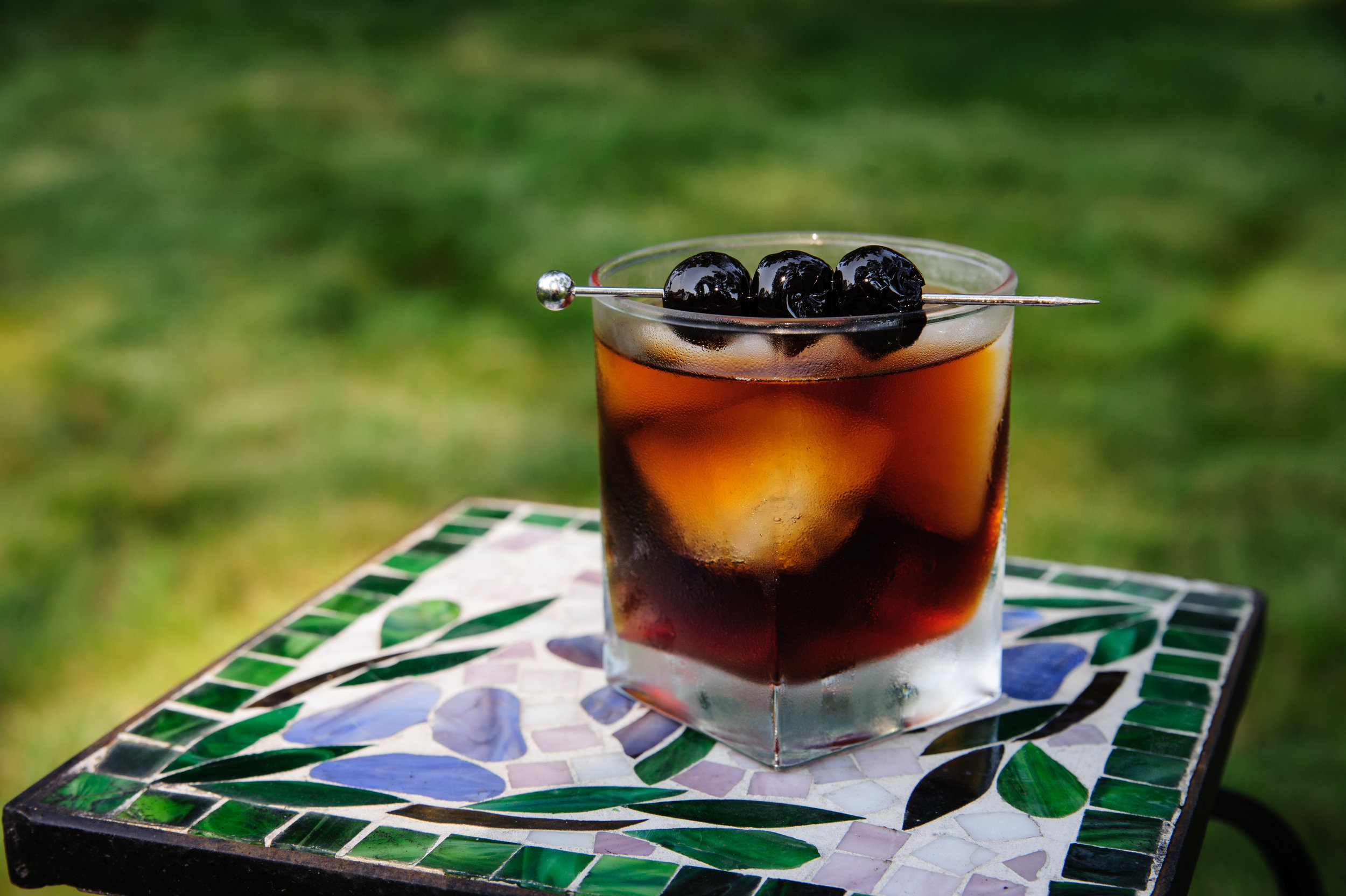 underneath bells crossing - 2 oz Wooden Boat Rum2 oz Cold brewed coffee (a dark blend)2 oz Sweet vermouth3-5 shakes of chocolate bittersStir with ice in mixing glass (30-40 stirs) Strain over fresh ice in chilled rocks glass.Garnish with 3 cherry's