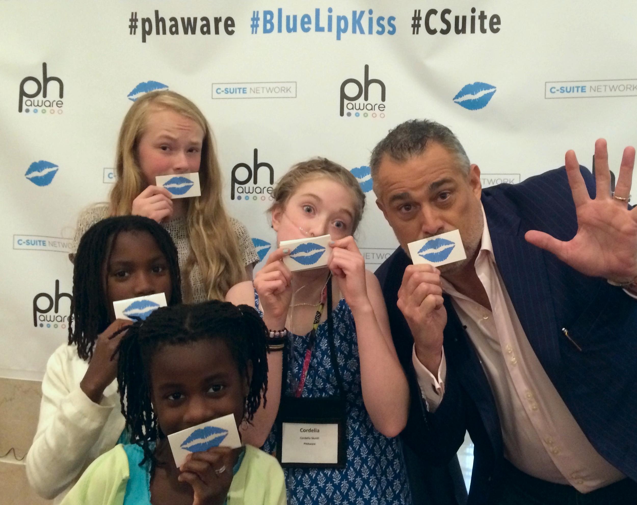 PH patient Cordelia Skuldt (center) and friends enlistJeffrey Hayzlett and hisC-Suite Network to take the #BlueLipKiss Challenge.