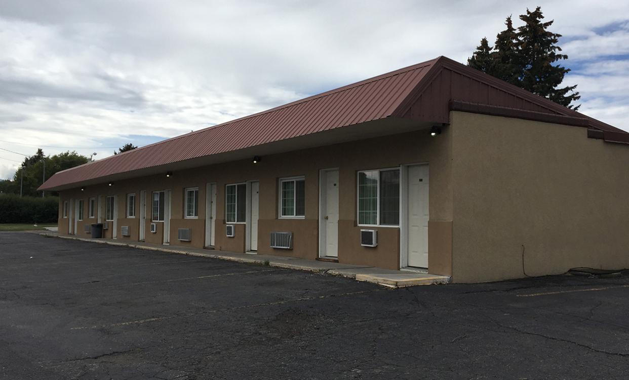 Rainbow Motel exterior before renovations.