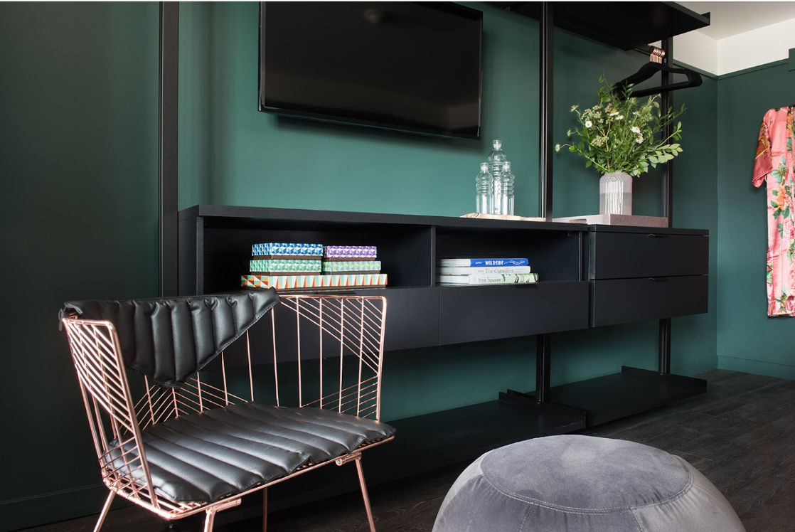Mid-century modern influences pay homage to the hotel's historic roots.