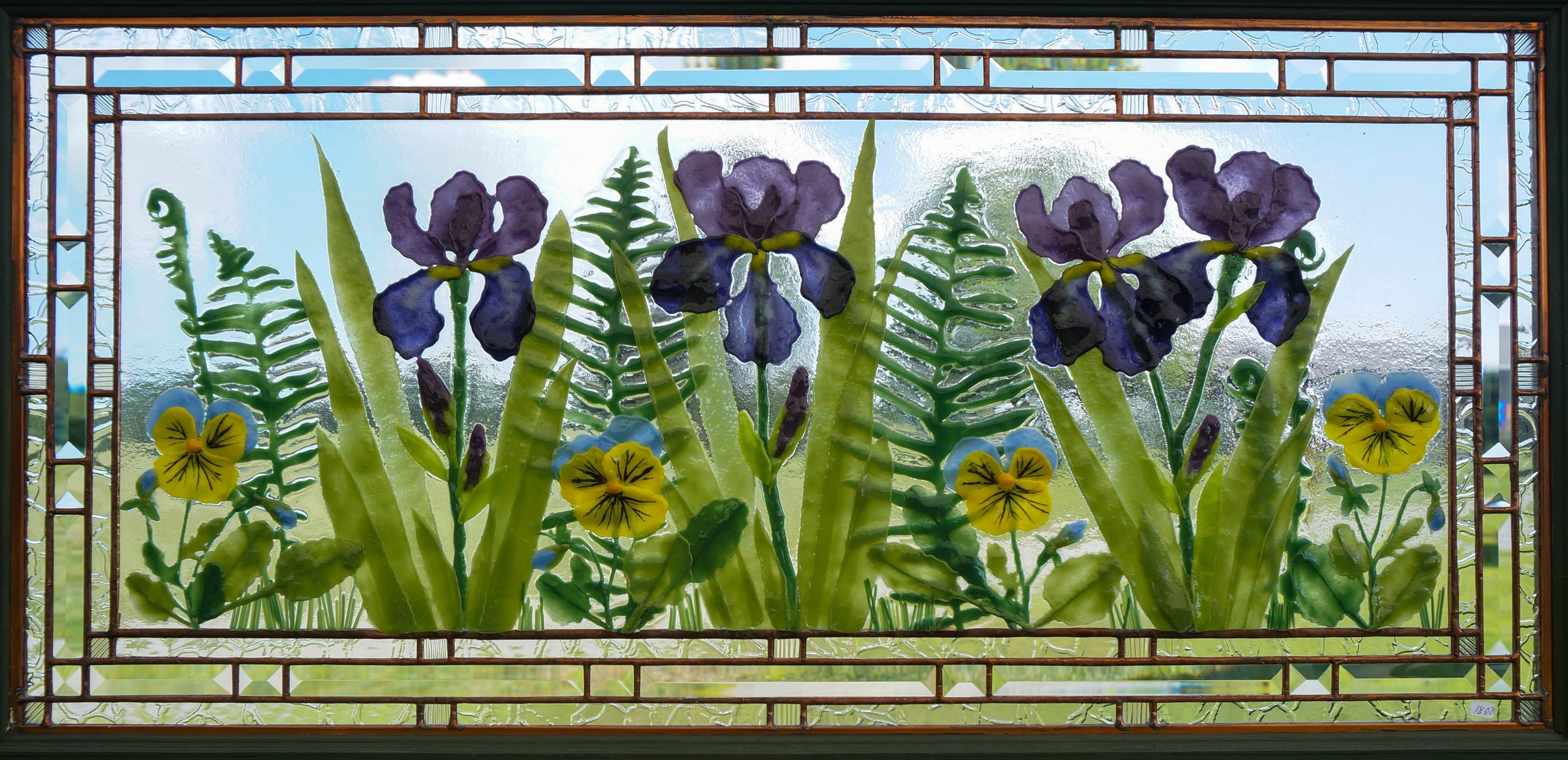 Iris and ferns with pansies