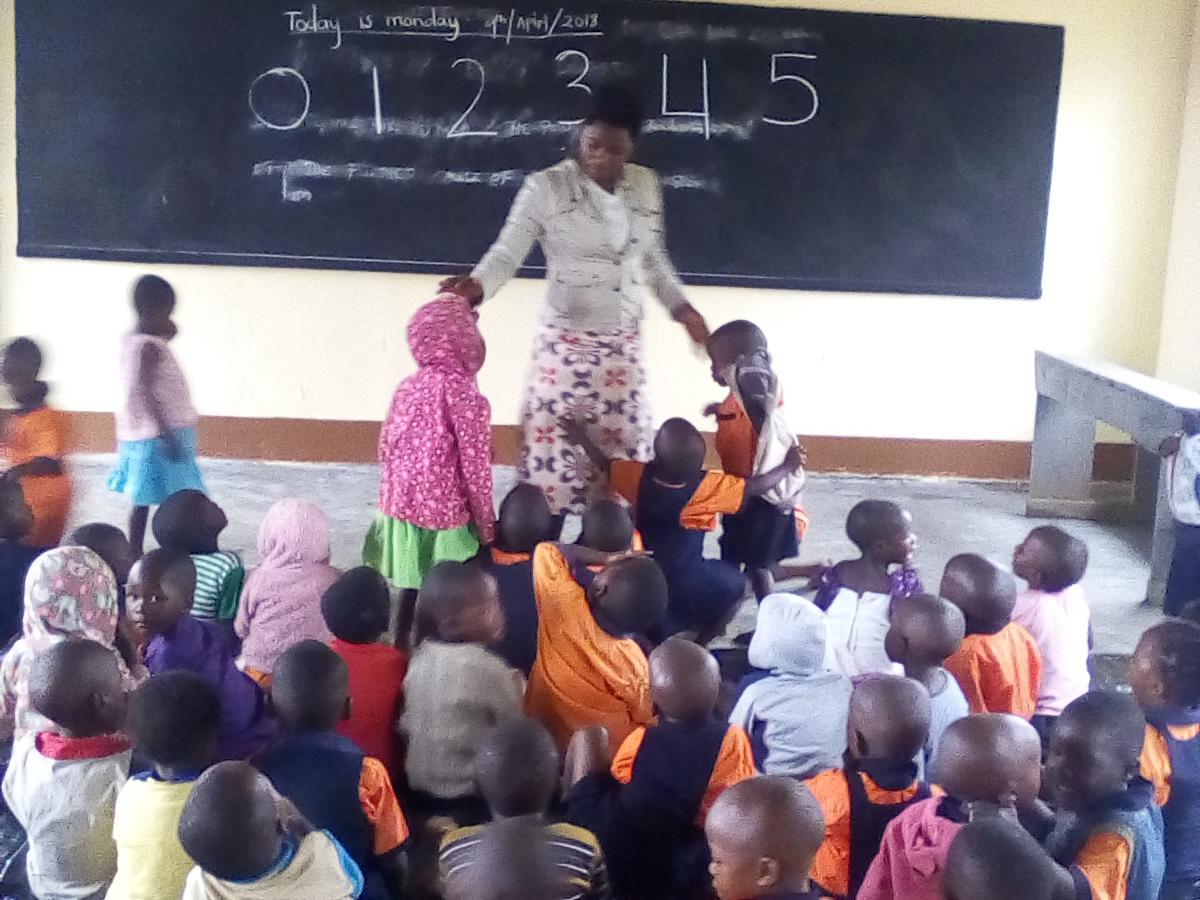 - Teacher welcomes the little ones too